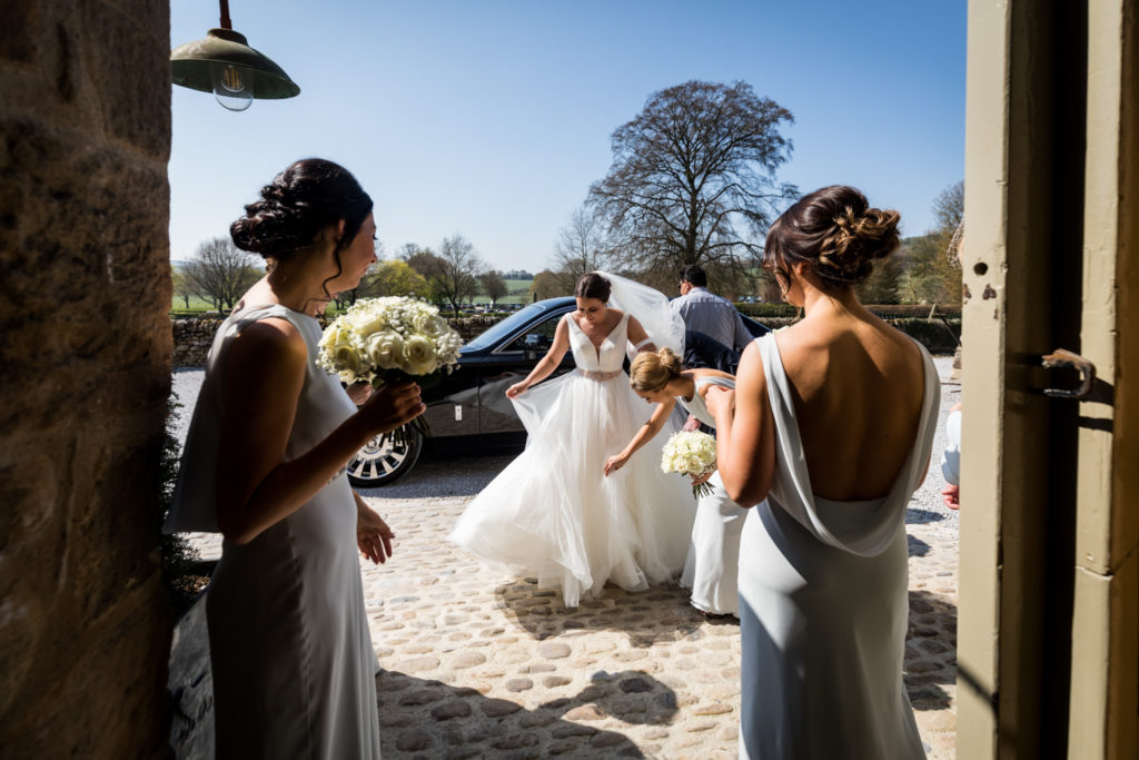 Tithe Barn Wedding Photography - Bride arriving at the barn