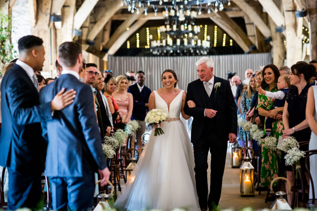 Tithe Barn Wedding Photography - Bride and Dad walk down the aisle