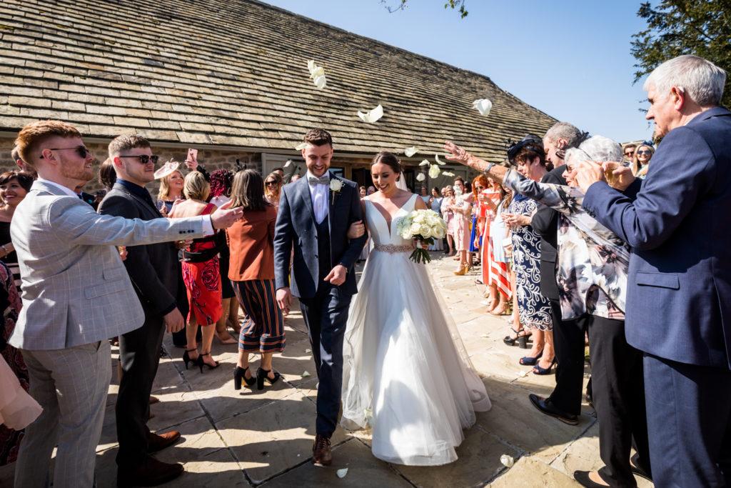 Tithe Barn Wedding Photography - Confetti outside the barn