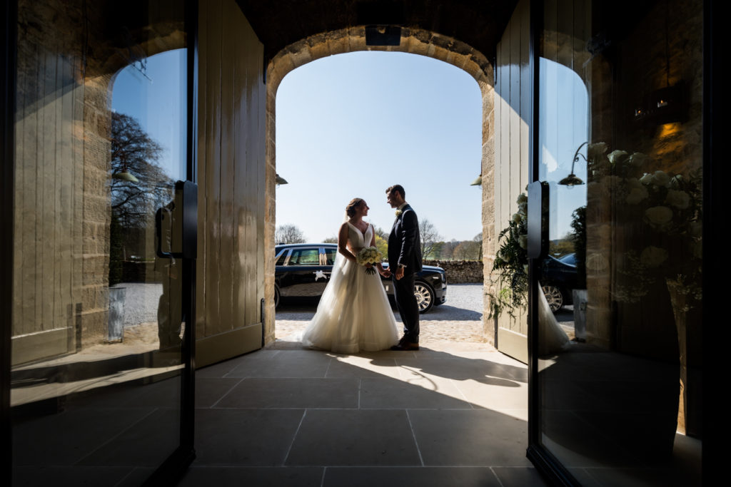 Tithe Barn Wedding Photography - Couple at the barn doors