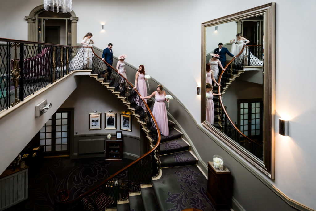 The Mansion Leeds Wedding Photography - bridal party on the grand staircase