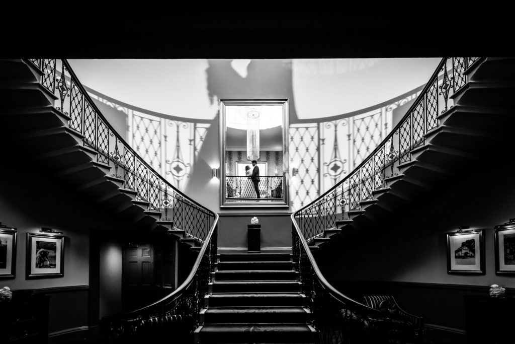 The Mansion Leeds Wedding Photography - bride & groom on the grand staircase