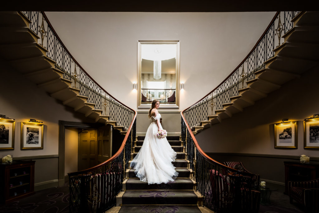The Mansion Leeds Wedding Photography - bride under the chandelier