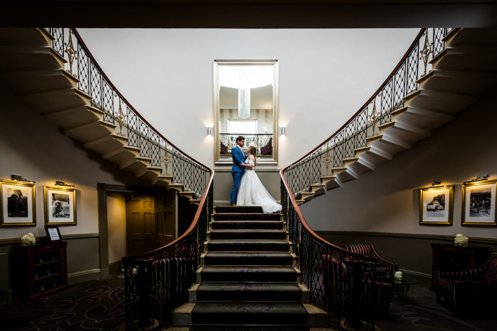 The Mansion Leeds Wedding Photography - couple on the grand staircase
