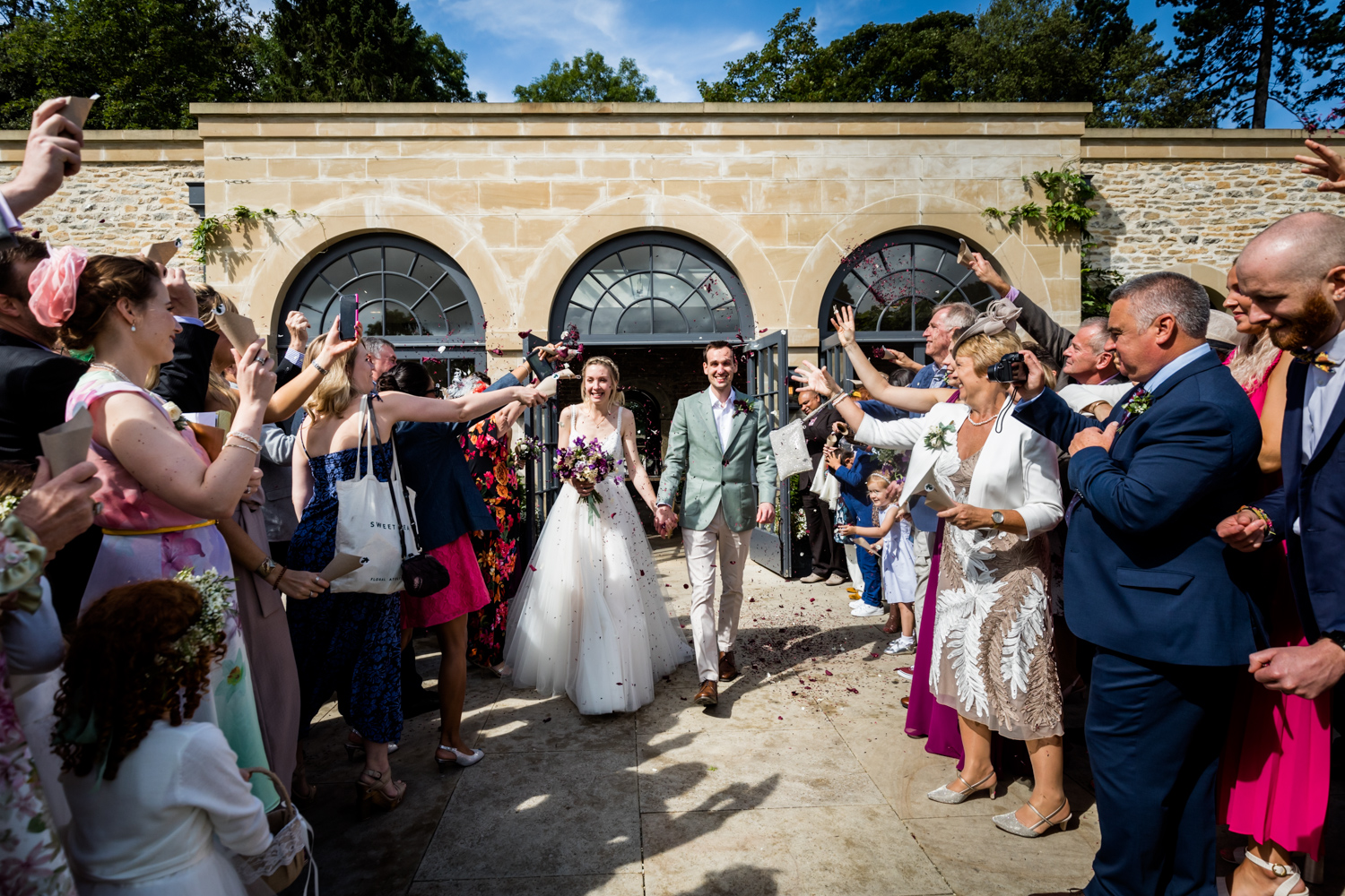 Middleton Lodge Wedding Photography - couple showered with confetti