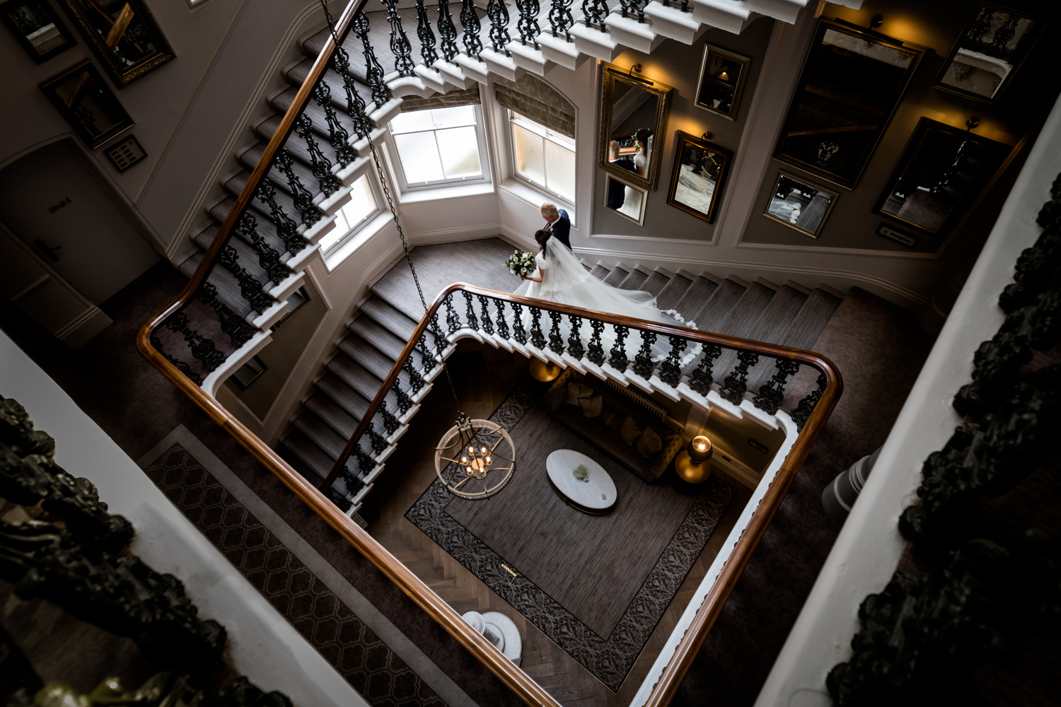Principal Hotel York Wedding Photographer - bride and her Dad walking down the grand staircase