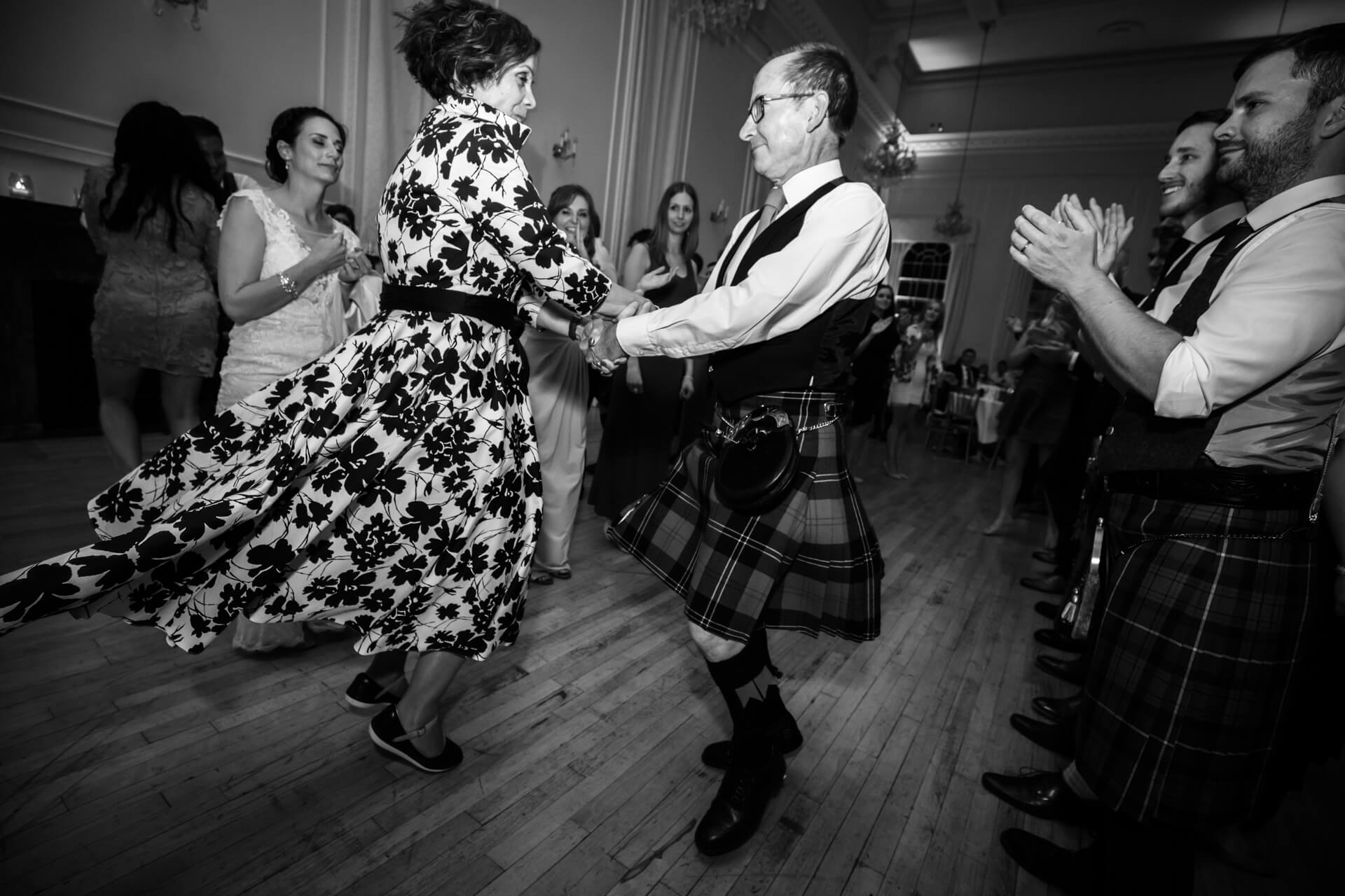 wedding guests dancing to a ceilidh