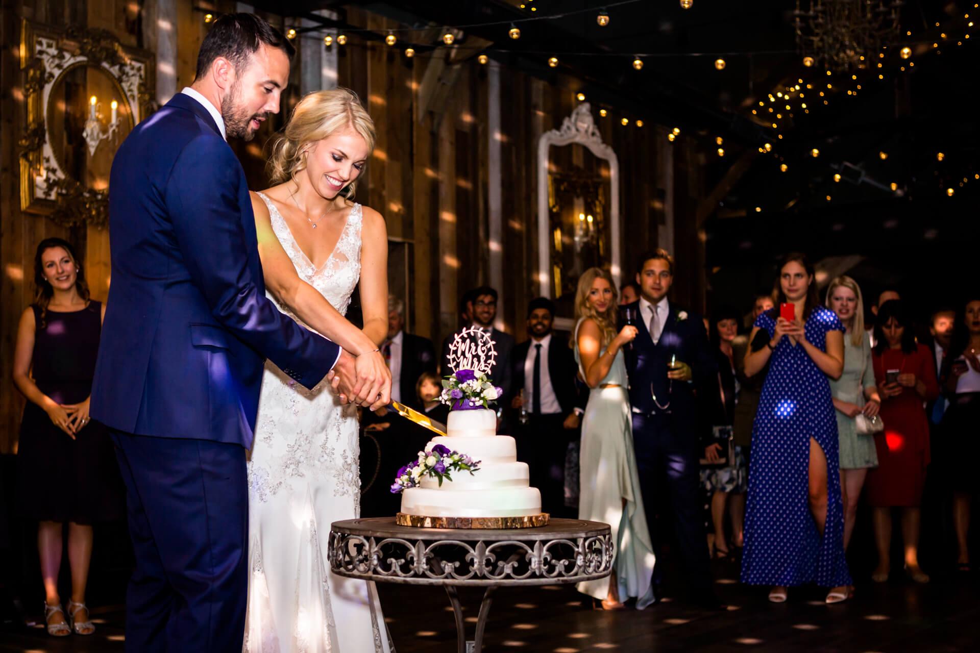 wedding couple cutting the cake at Wharfedale Grange