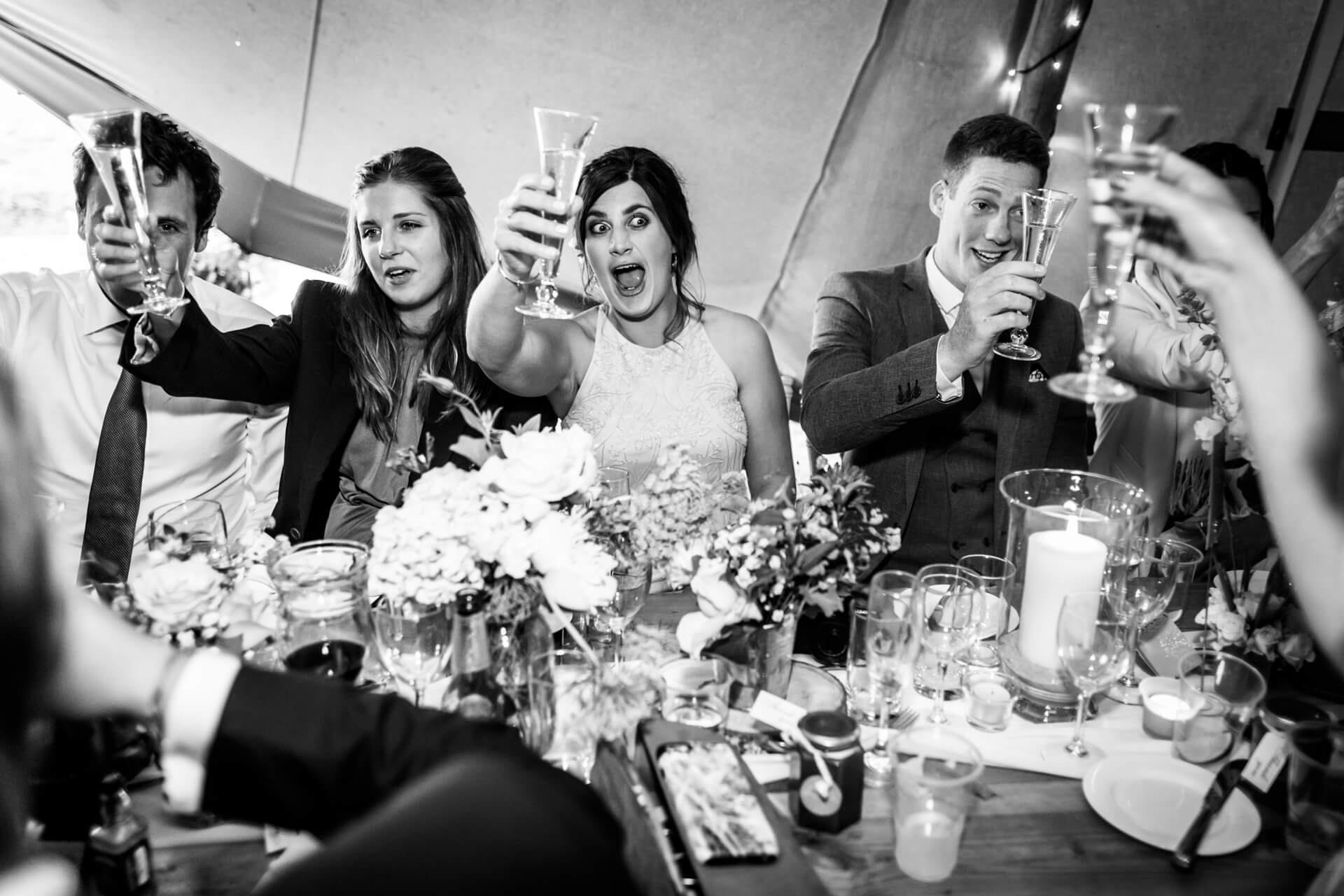 wedding guests cheering during the speeches