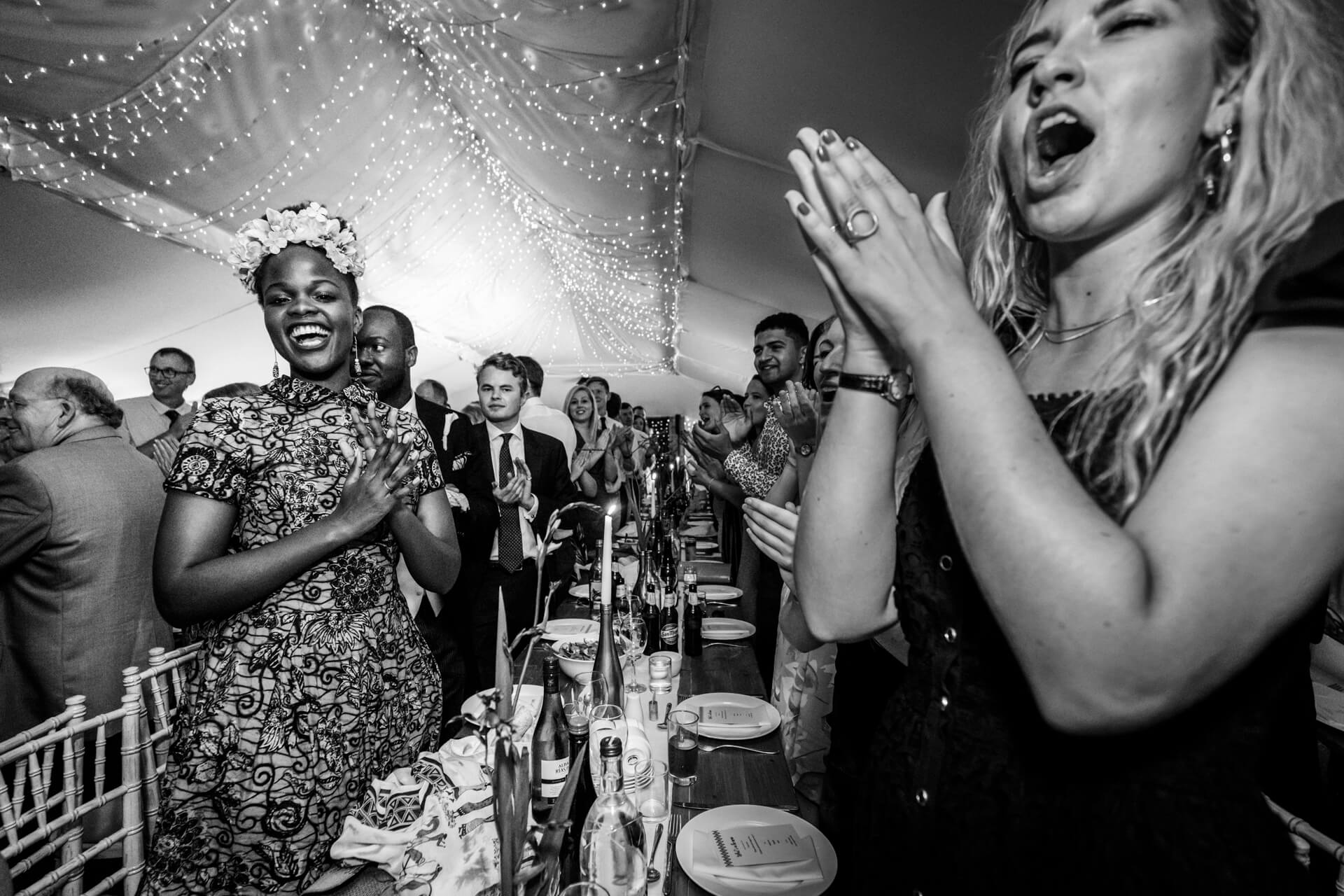 wedding guests clapping during the speeches