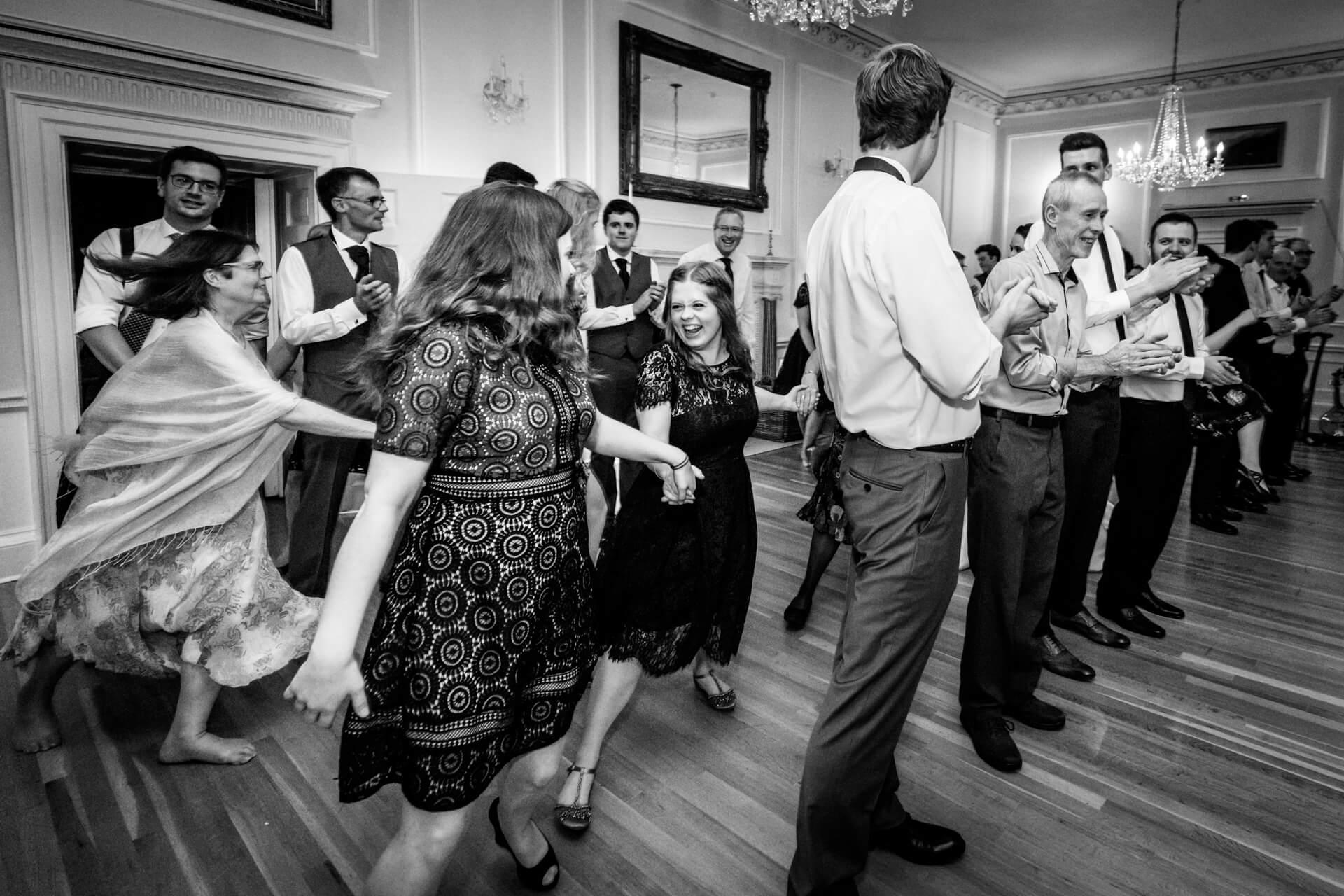 wedding guests dancing a ceilidh