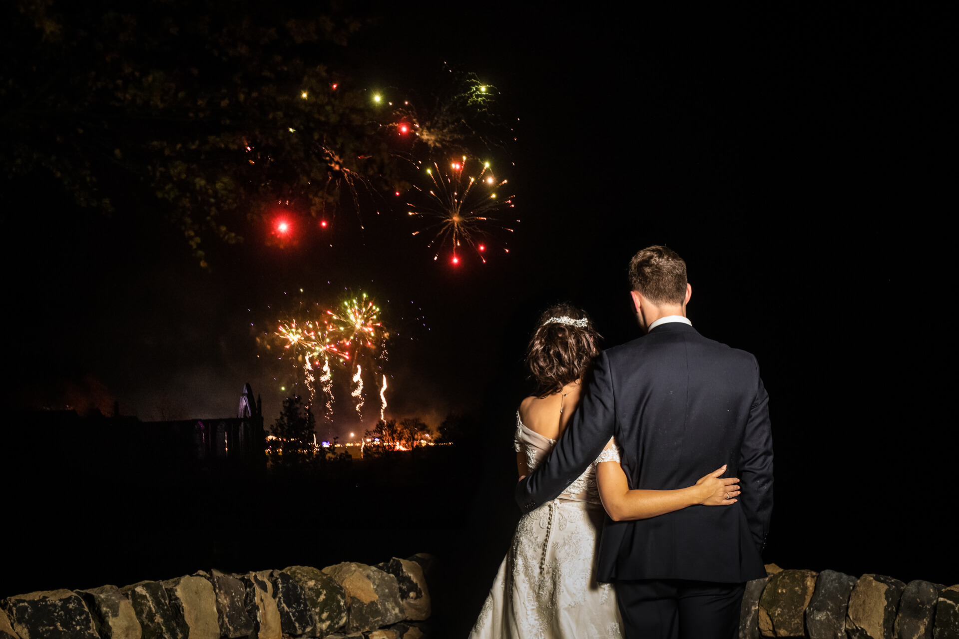 bride and groom watching some fireworks