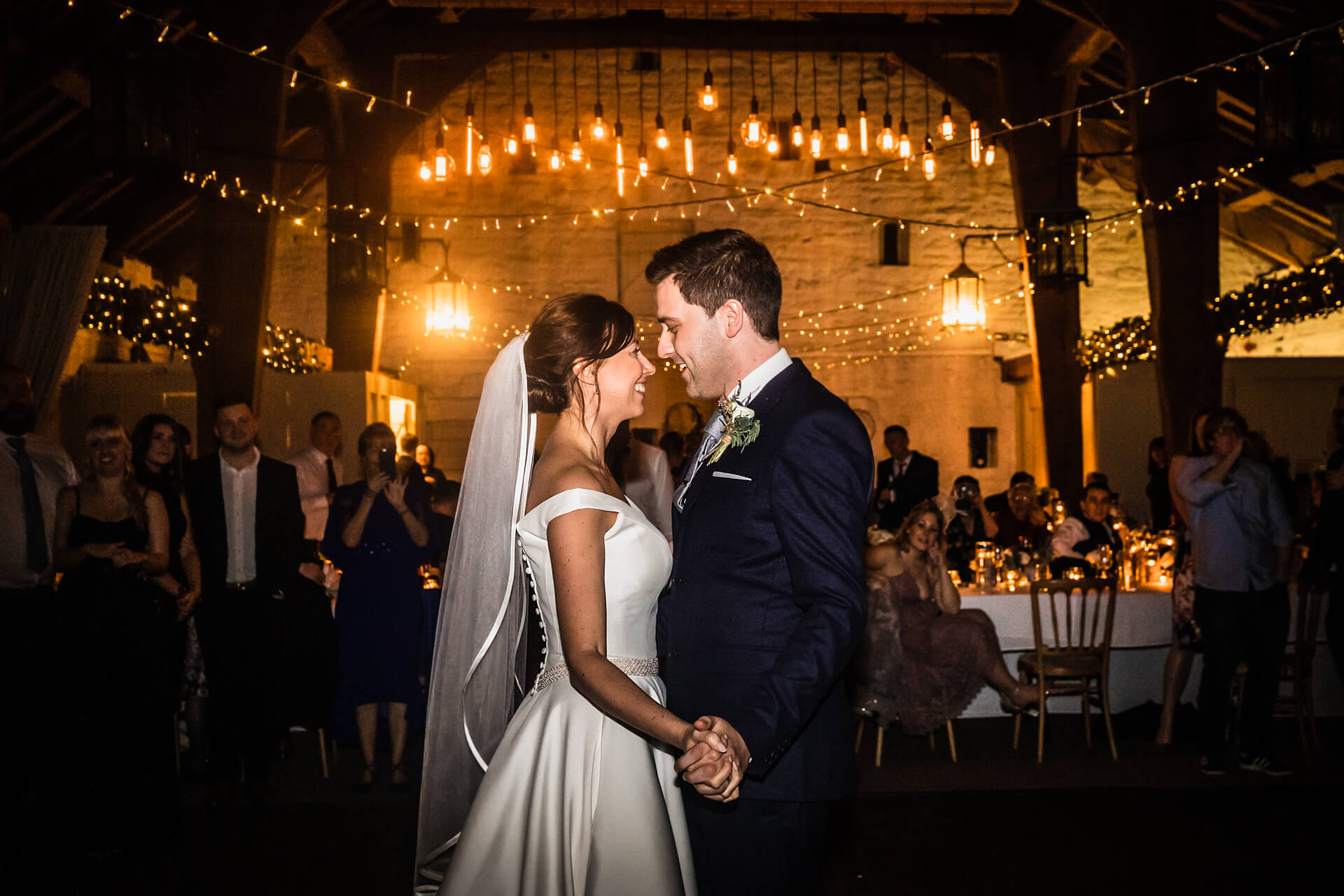 bride and groom having their first dance at East Riddlesden Hall