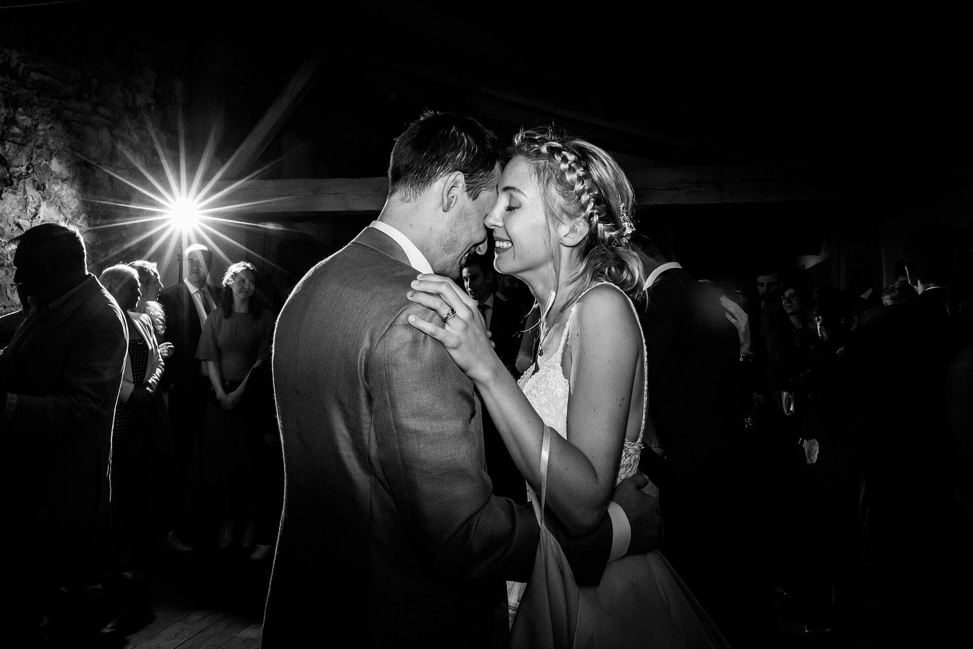 bride and groom dancing together at Middleton Lodge
