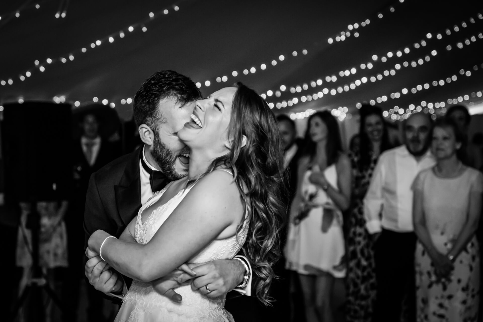 bride and groom laughing together during their first dance