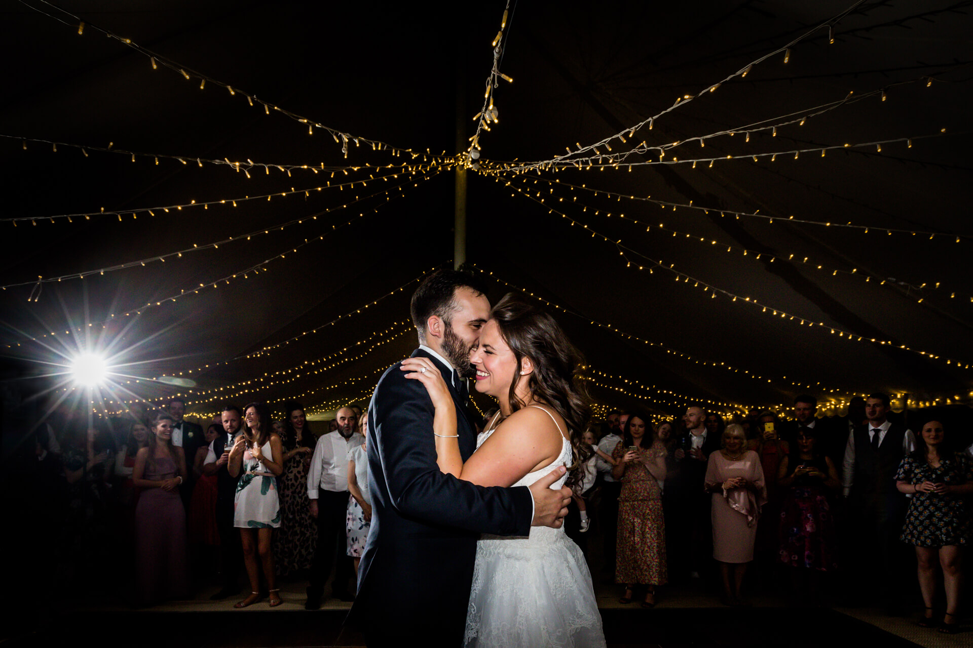 bride and groom hugging during their first dance