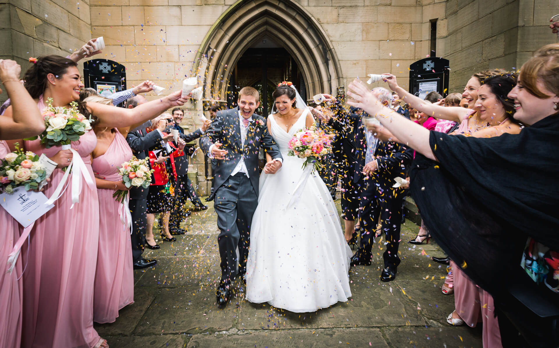 couple being showered with confetti outside Wakefield Cathedral