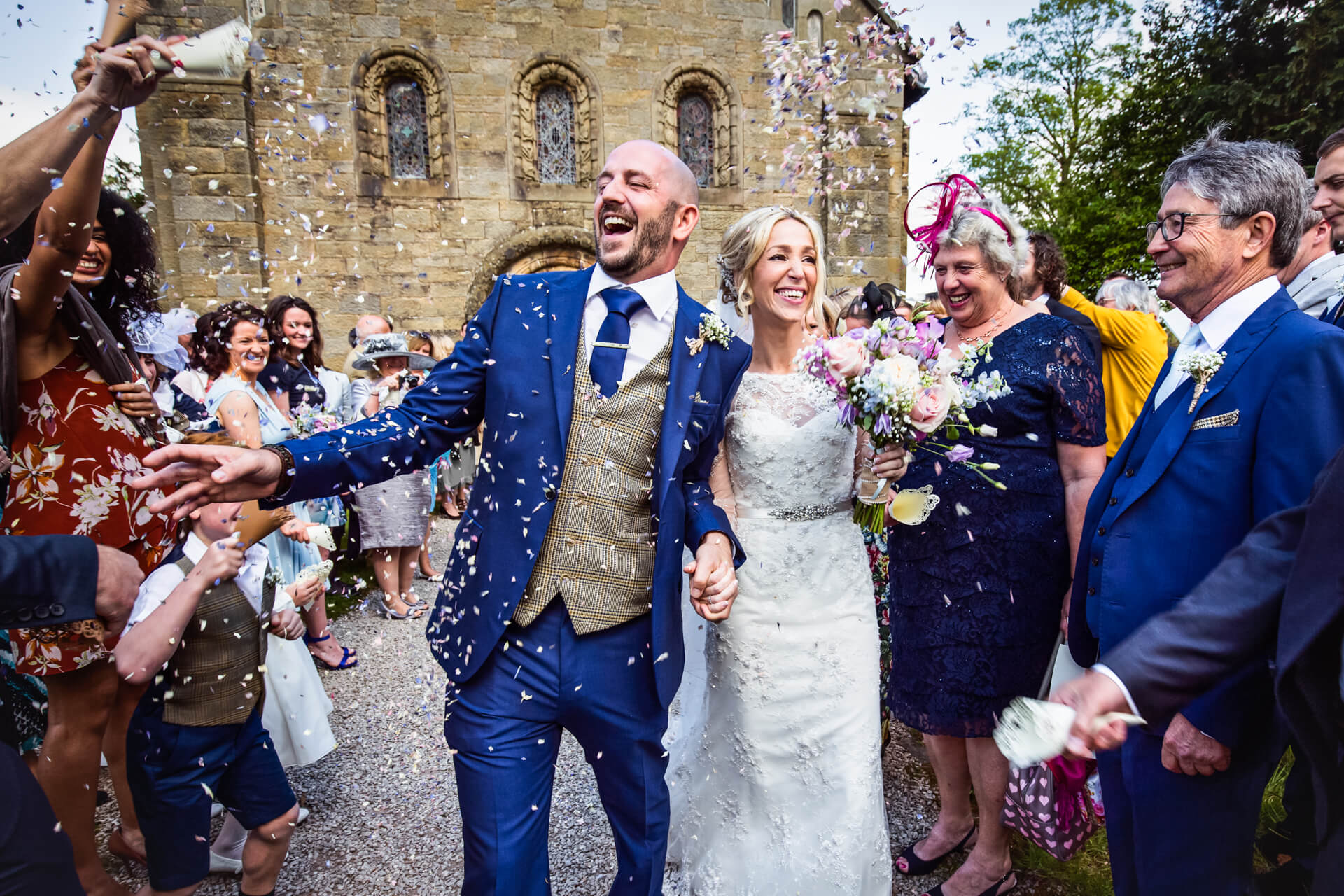 Lake District wedding-couple being showered with confetti