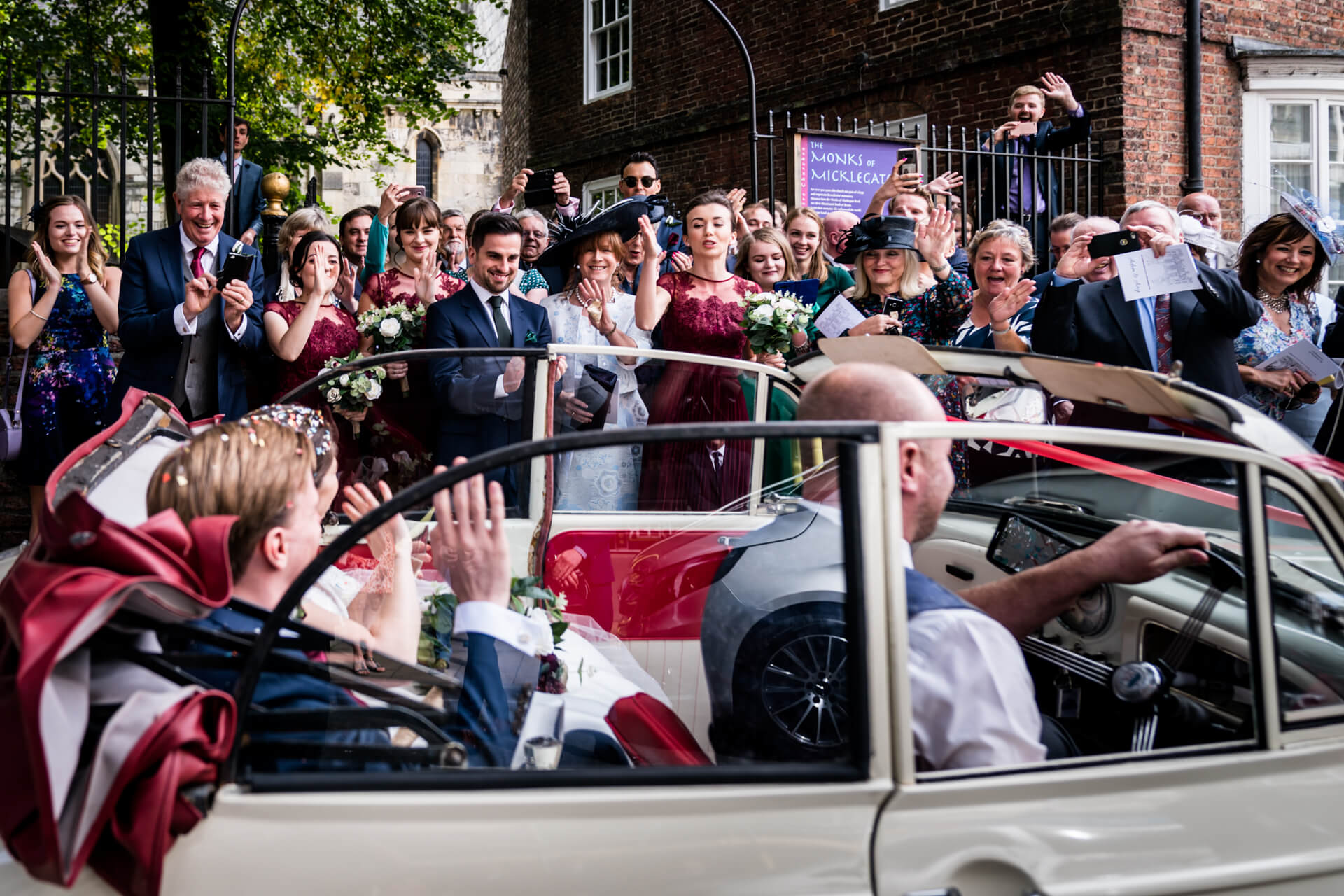 couple in their car covered with confetti
