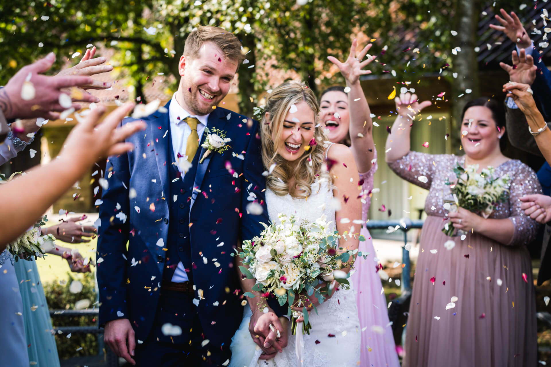 Guests throwing confetti over the couple at Otley Chevin wedding venue