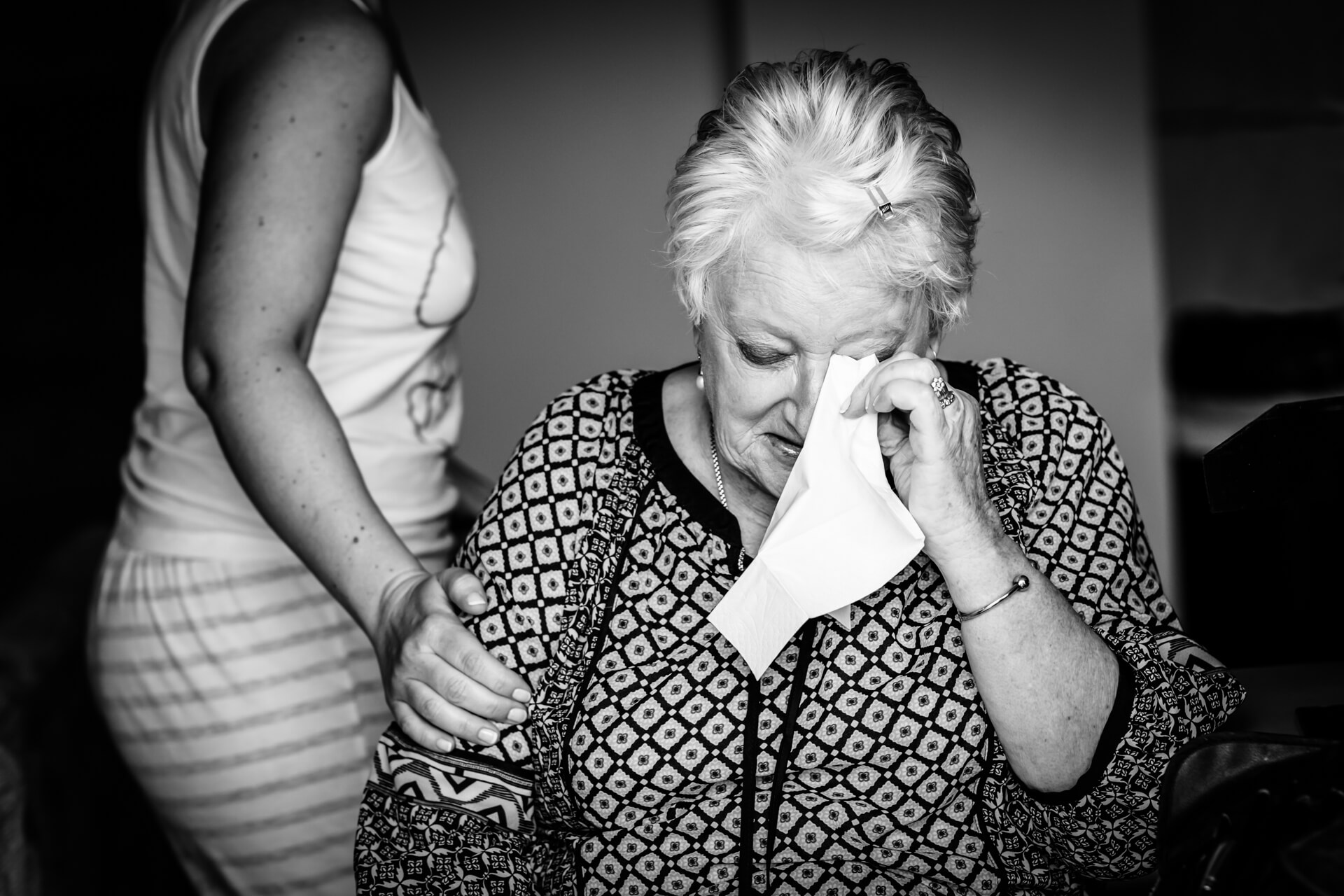 mother of the bride shedding a tear
