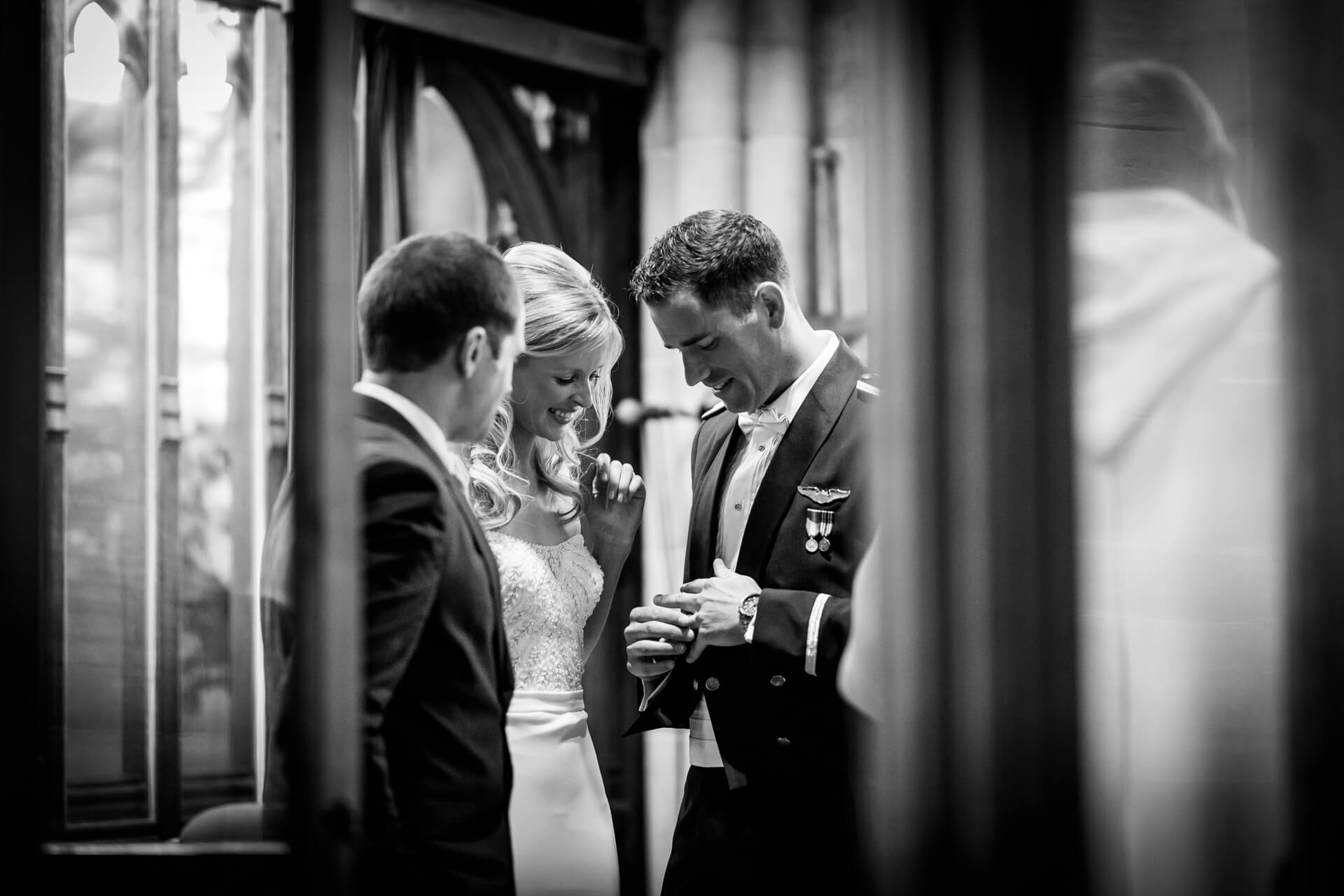 groom showing the bride his ring in the church