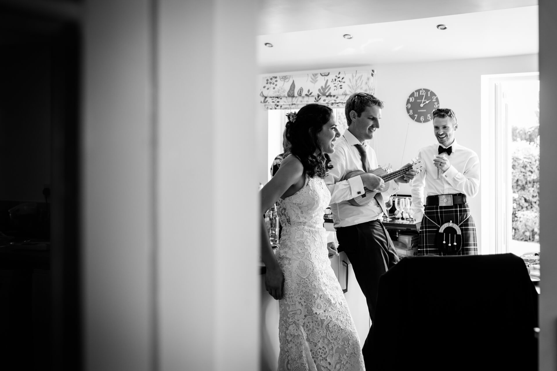 groomsmen and the bride paying the guitar and singing