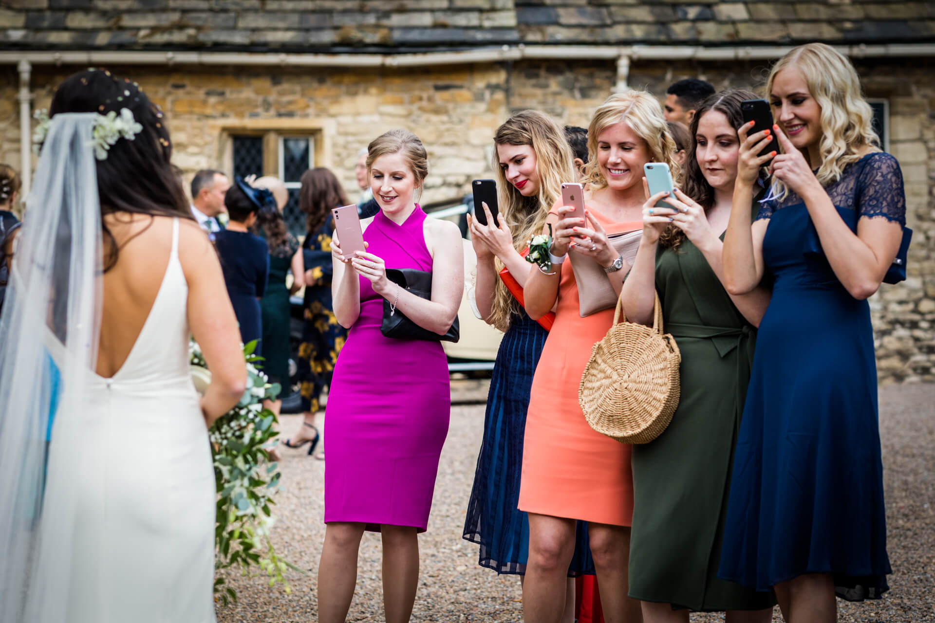 the brides friends all taking a photo of her