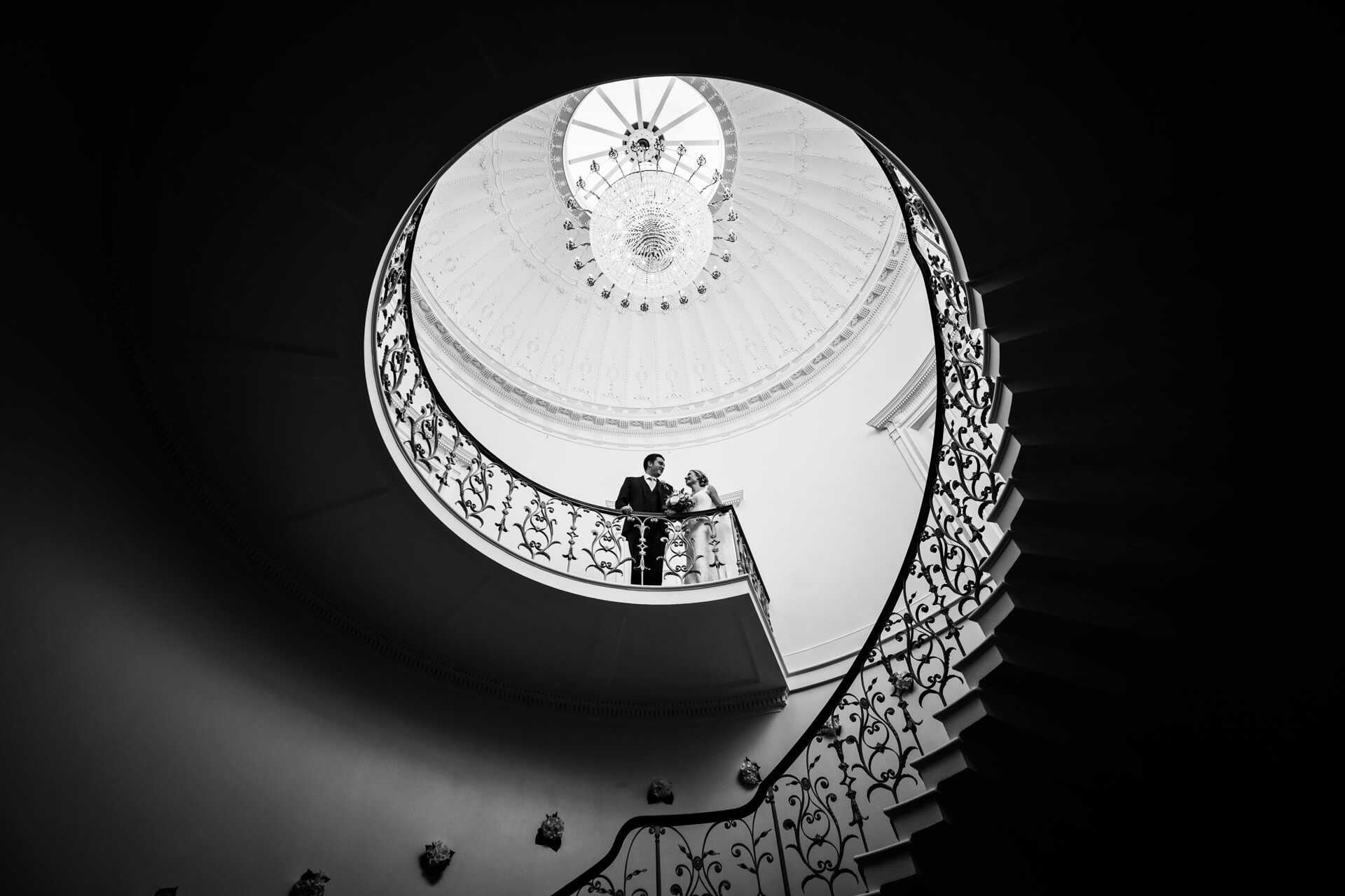 bride and groom at the top of the staircase at Denton Hall