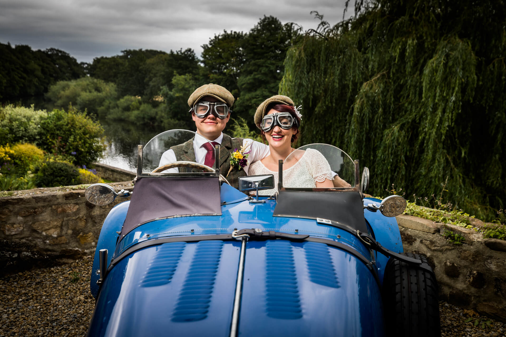 bride and groom sitting in a classic car