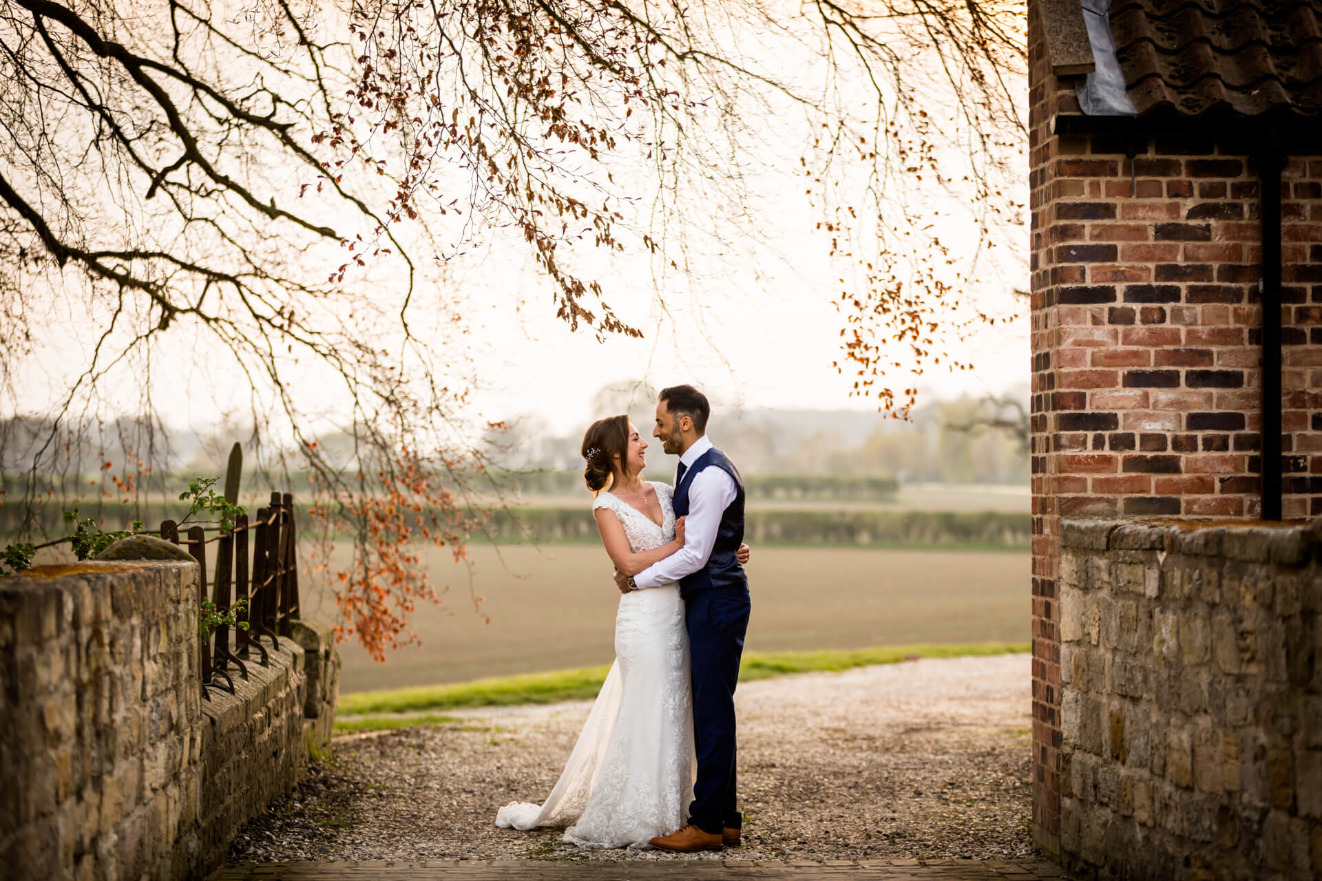 wedding couple hugging on a country lane