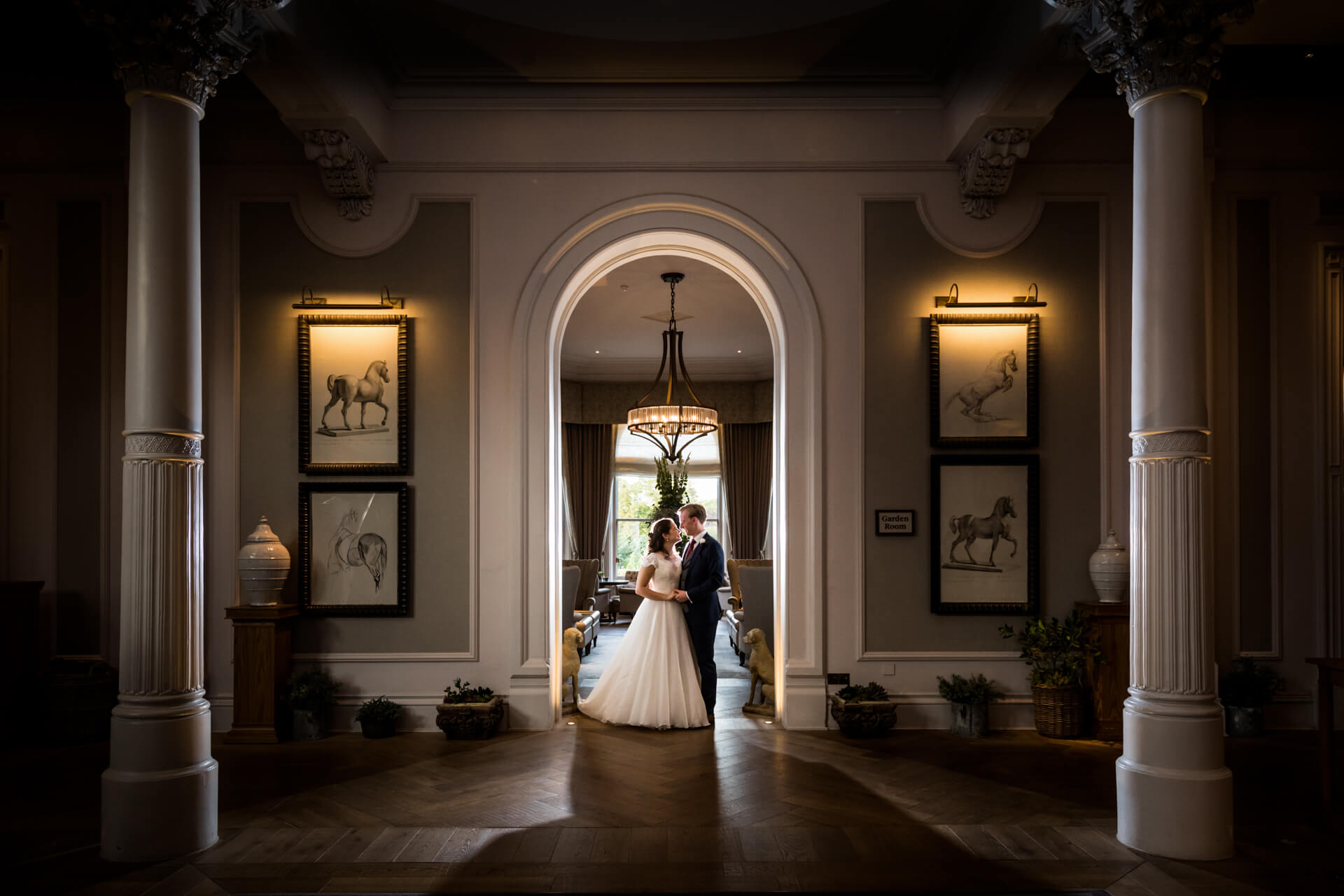wedding couple standing in a doorway in a hotel