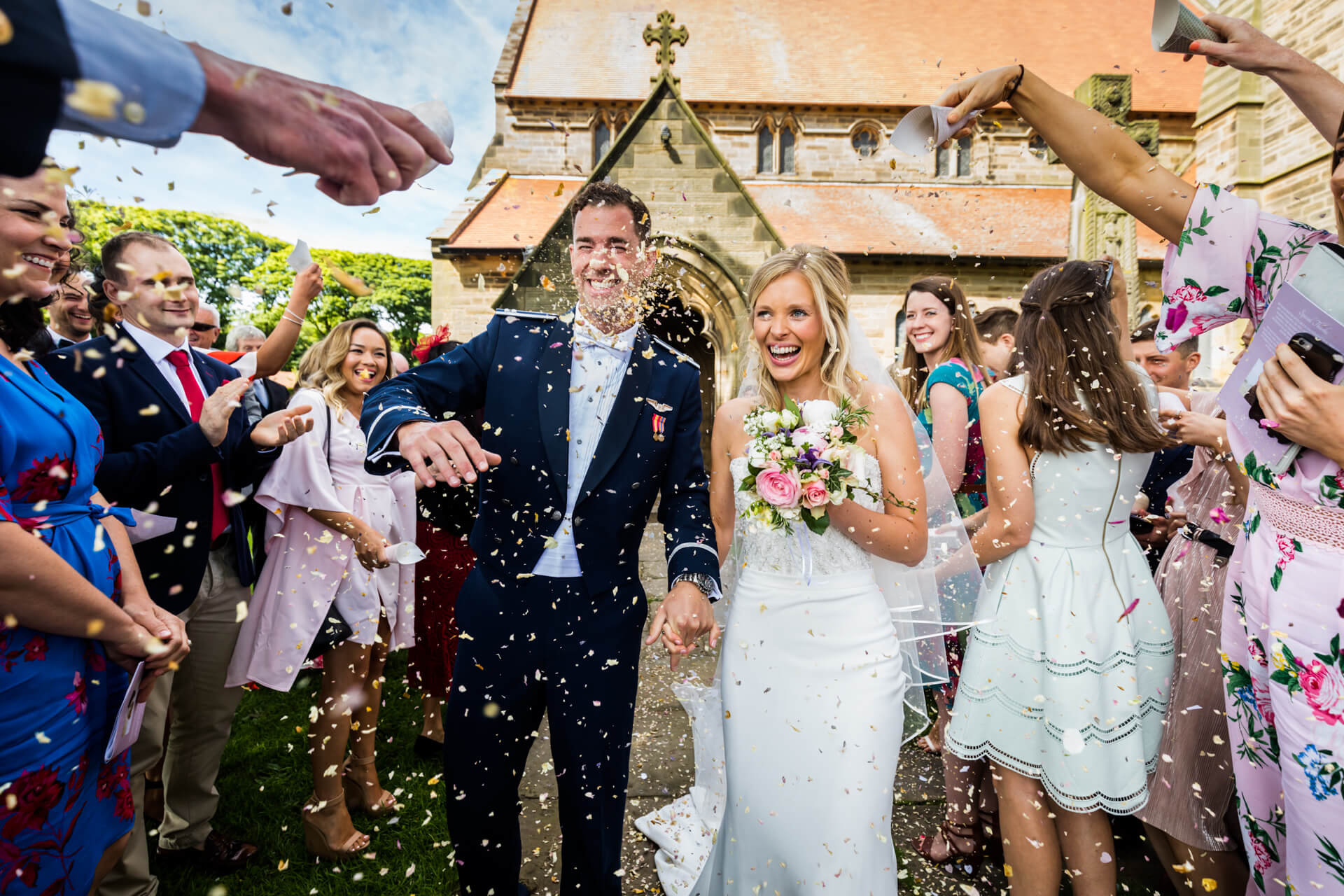wedding couple being showered with confetti