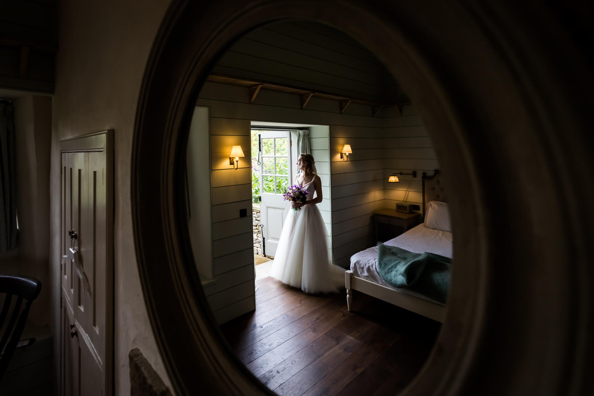 reflection ina mirror of the bride looking out of a window