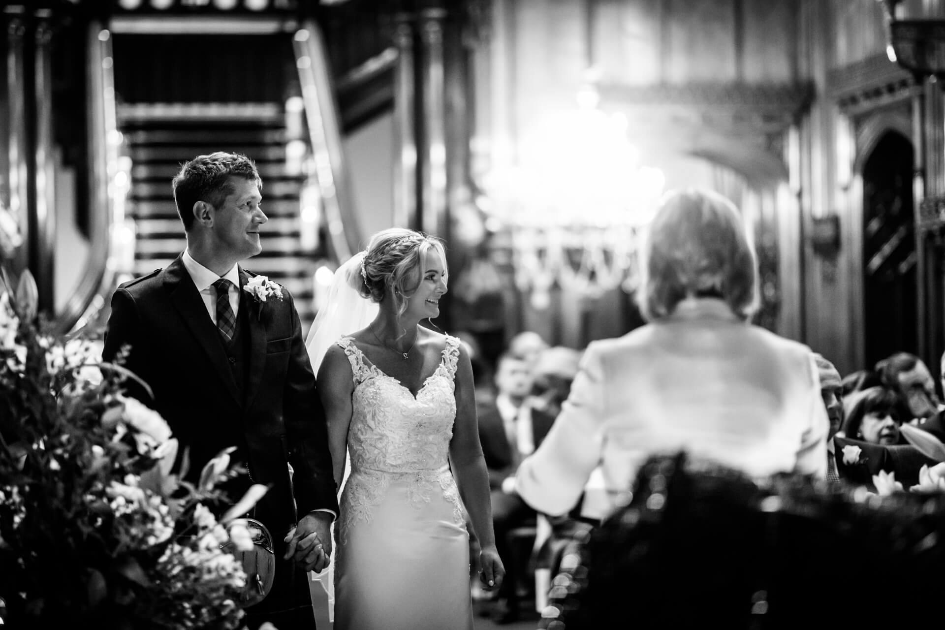 bride and groom holding hands during the ceremony