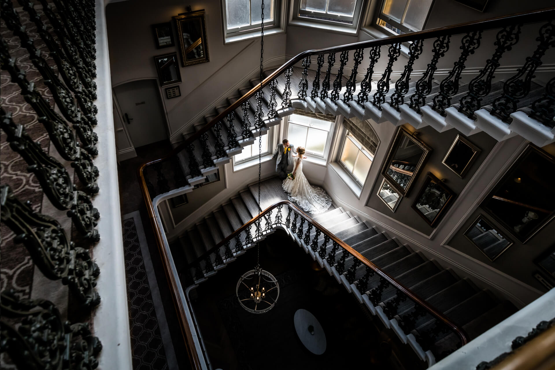 bride and groom standing on the staircase at The Principal hotel in York