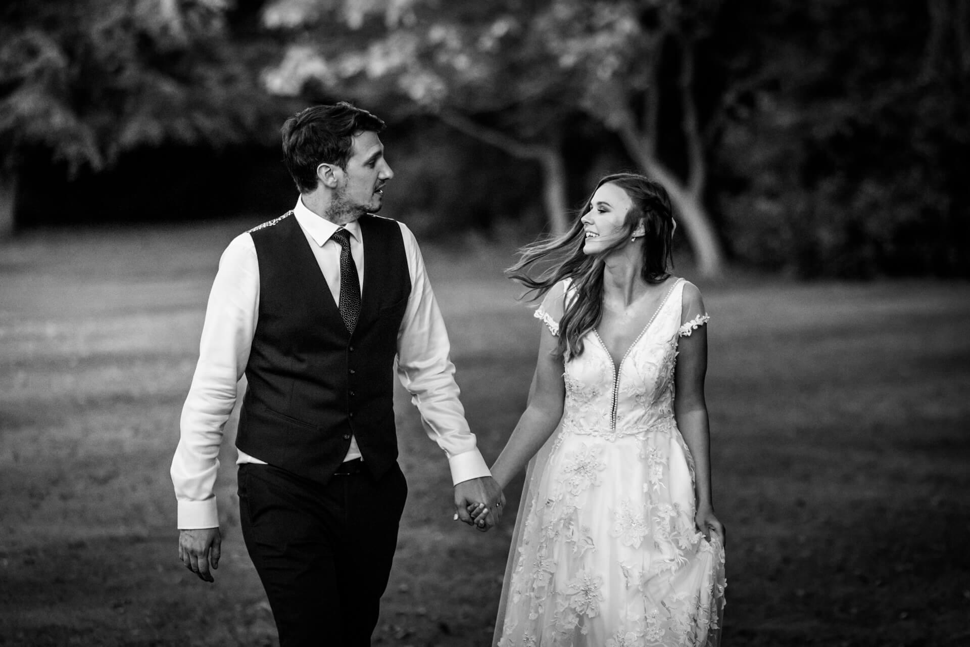 wedding couple walking in some gardens