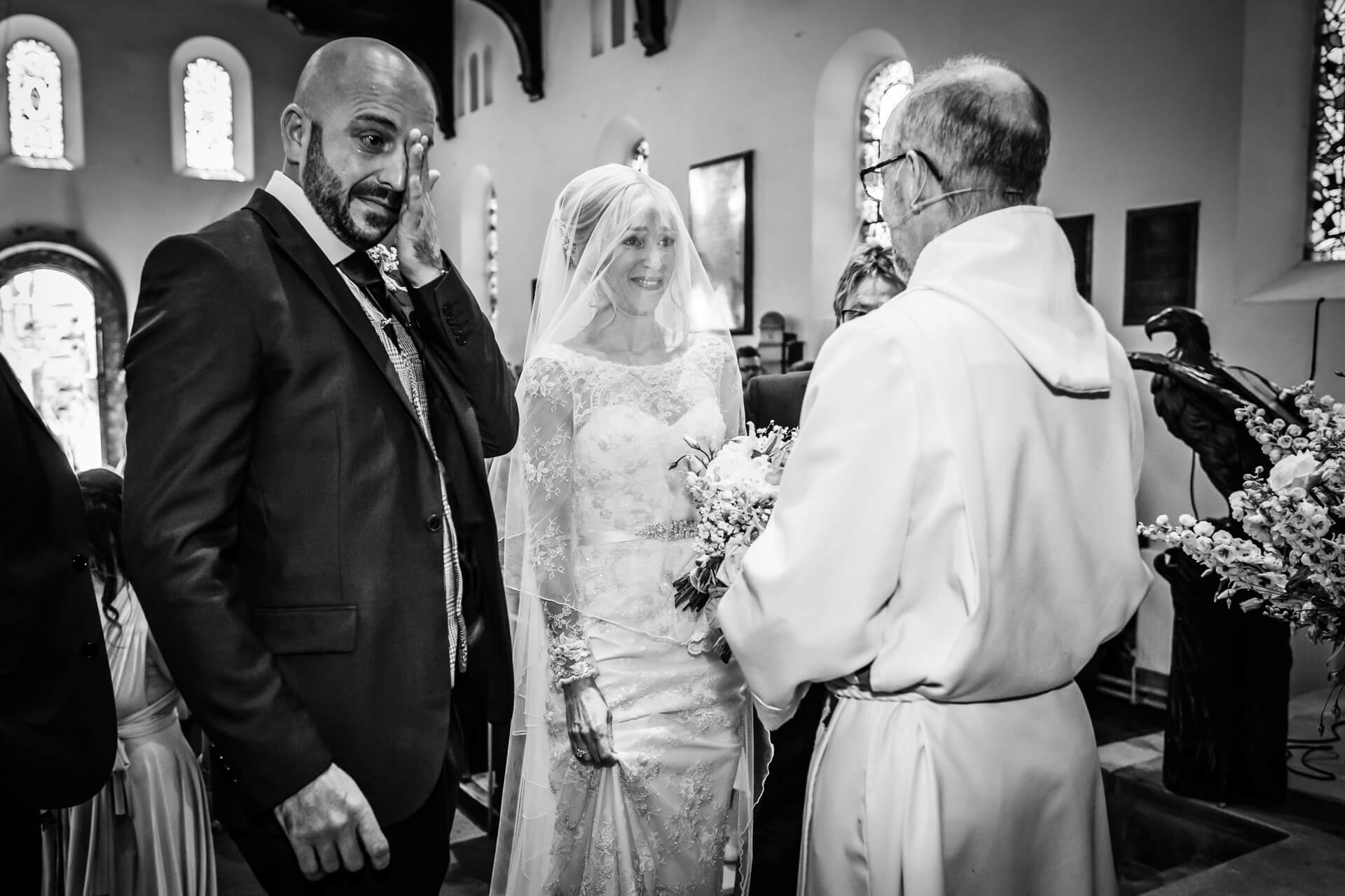 groom shedding a tear during the wedding vows