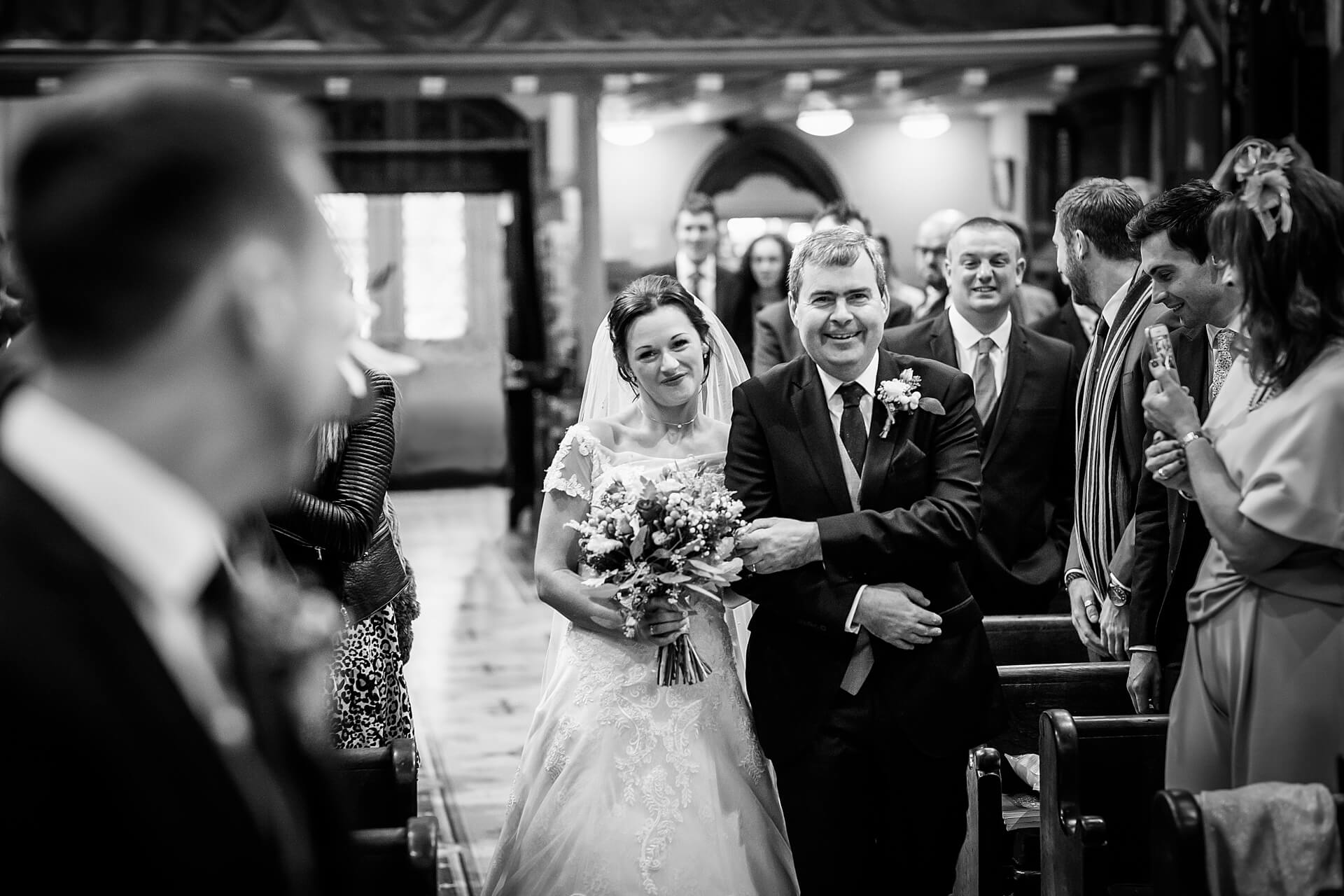 bride and her dad walking down the aisle