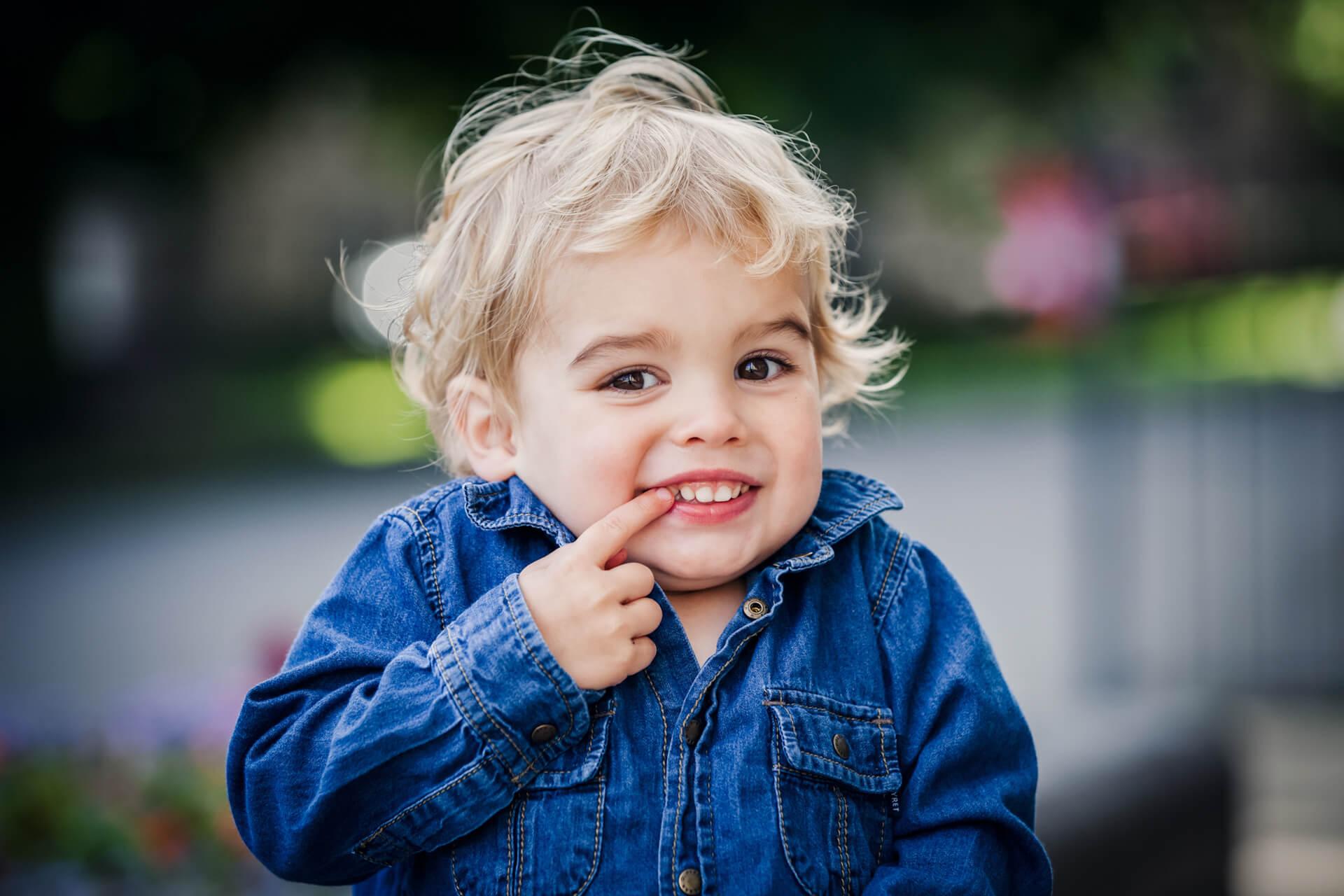 small boy smiling at the camera