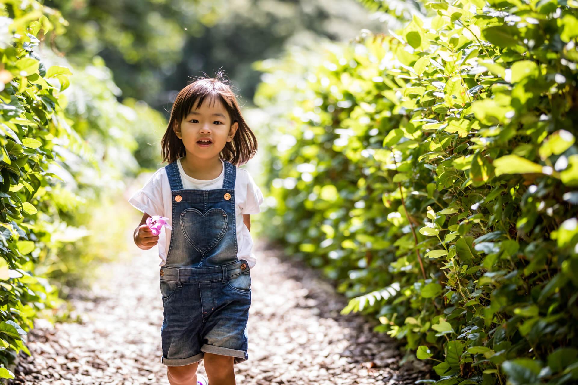 little girl running down a path