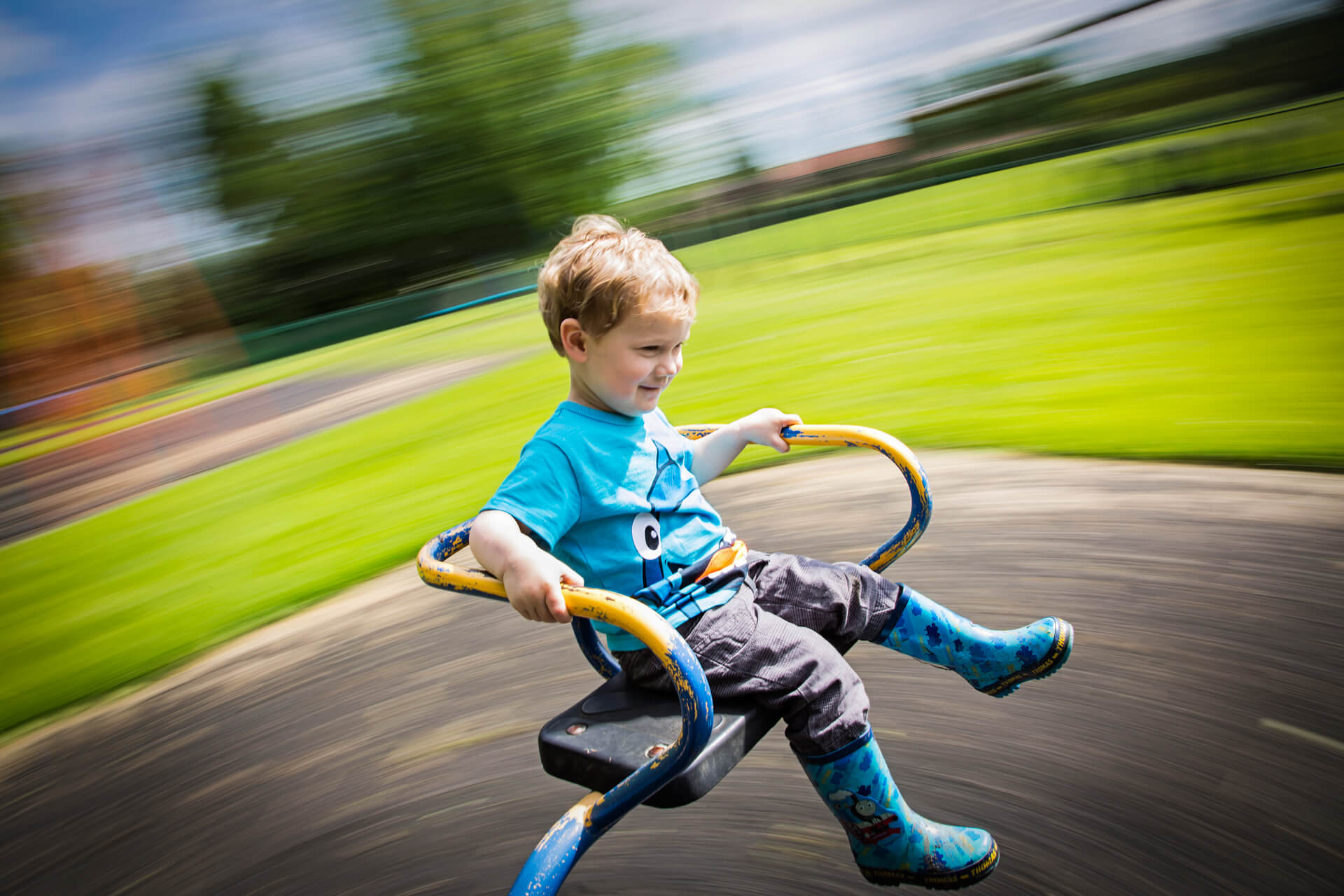yorkshire wedding photography - boy spinning on a roundabout