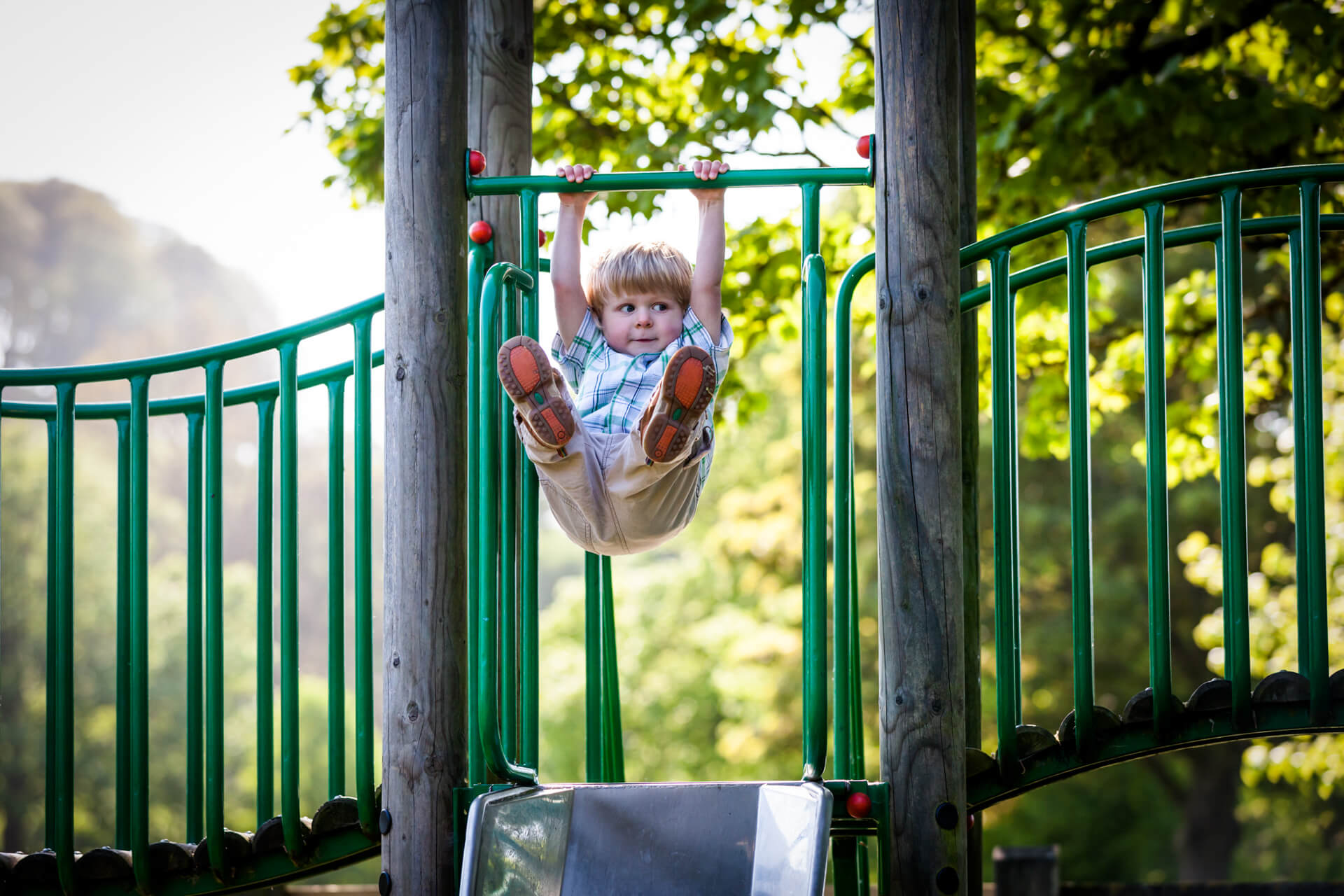 boy swinging in a playground in yorkshire