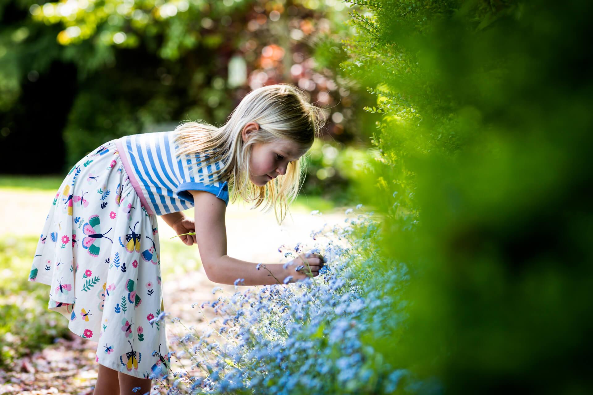 girl picking flowers in her garden