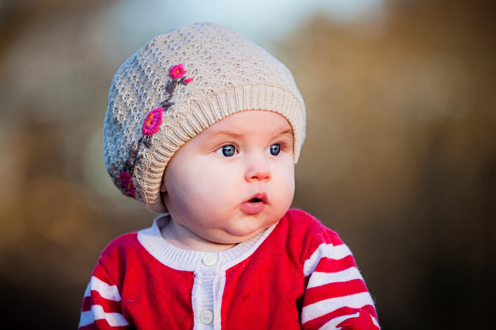 portrait of a baby in winter clothes and wooly hat