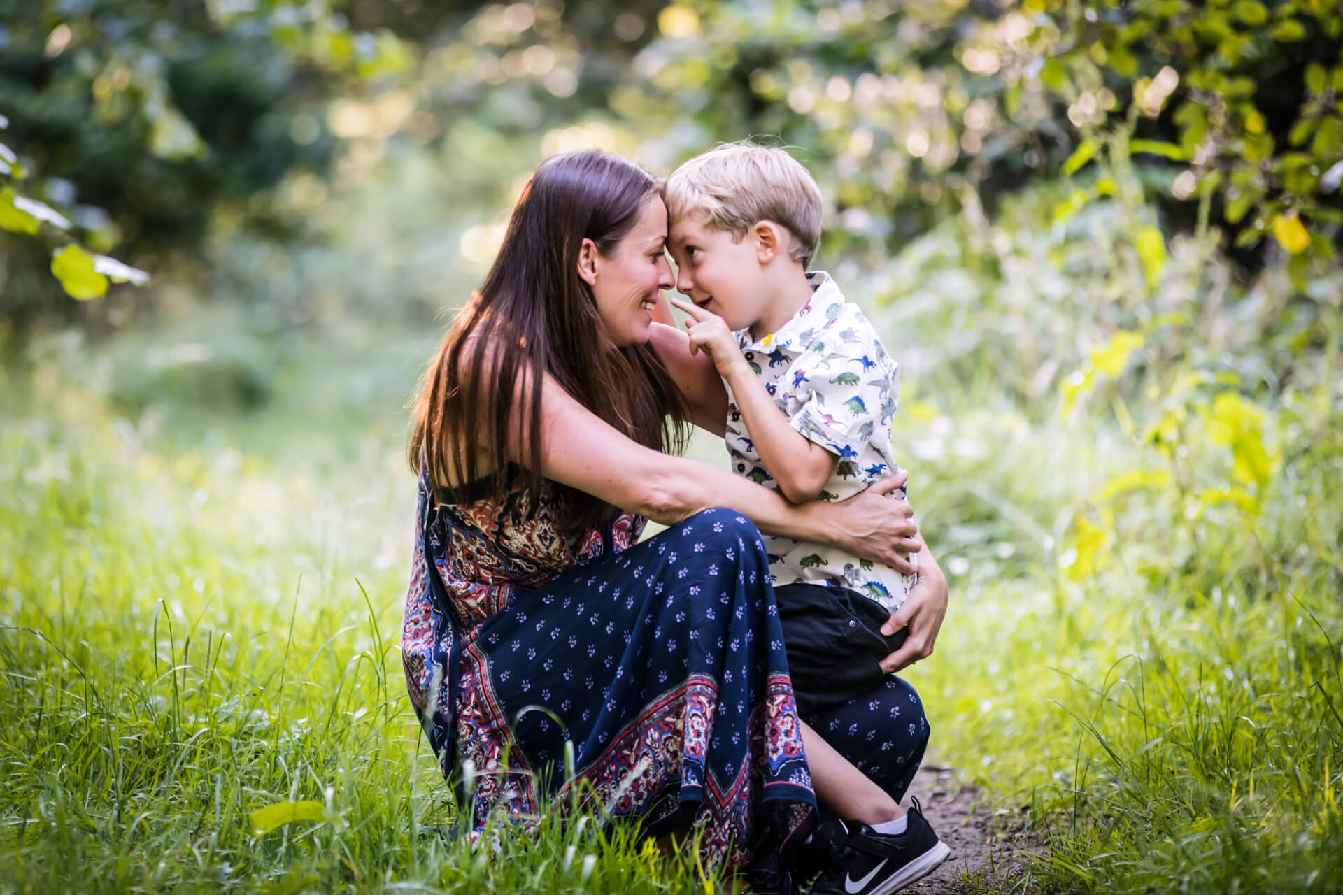 boy and his mother cuddling and smiling at each other in yorkshire