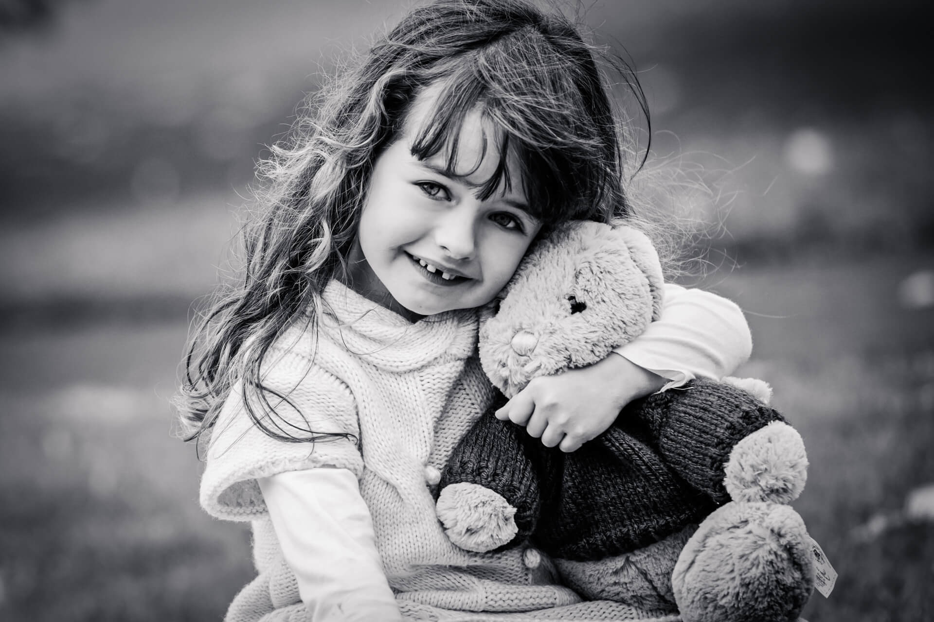 little girl cuddling her teddy bear