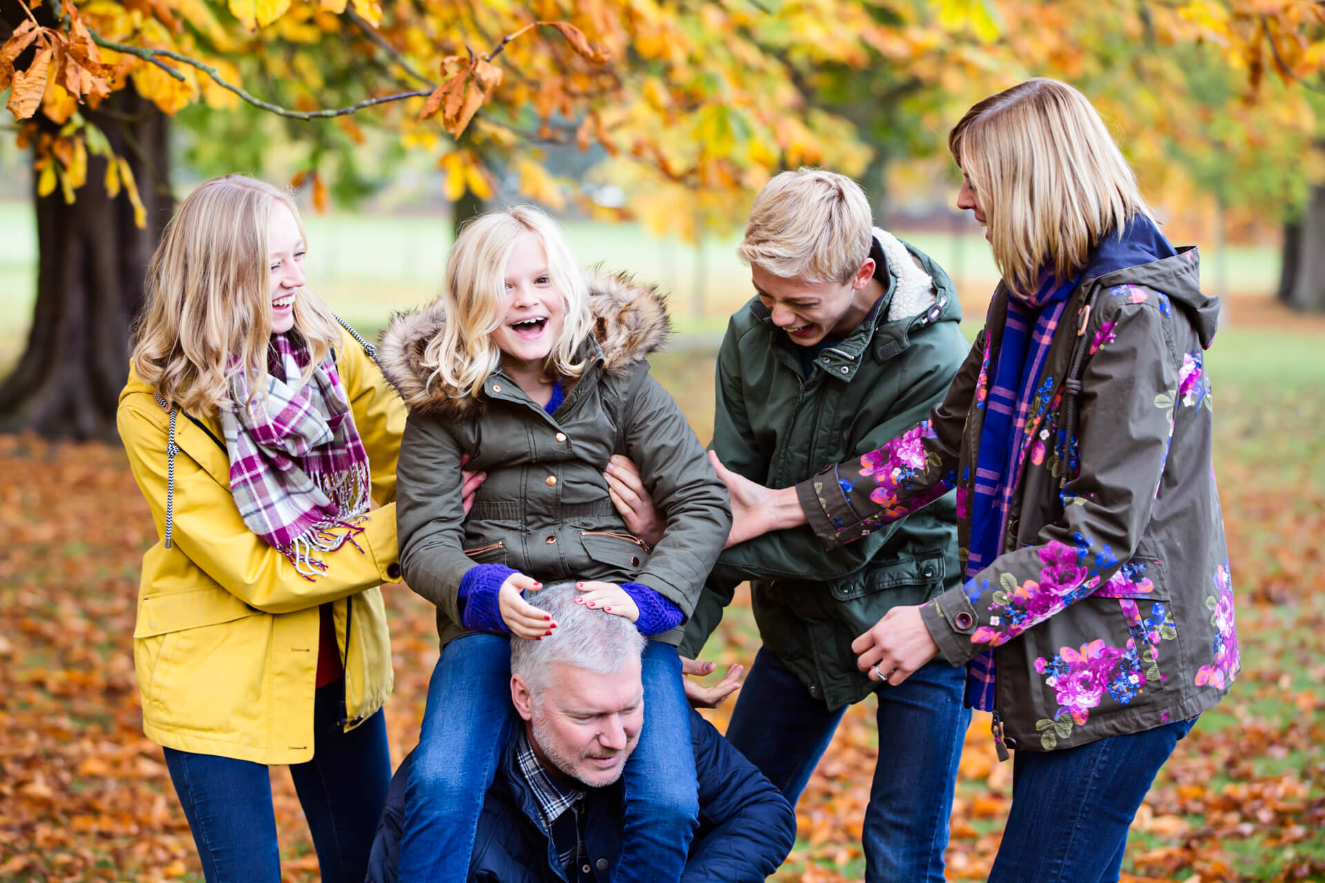 family laughing together in a harrogate park