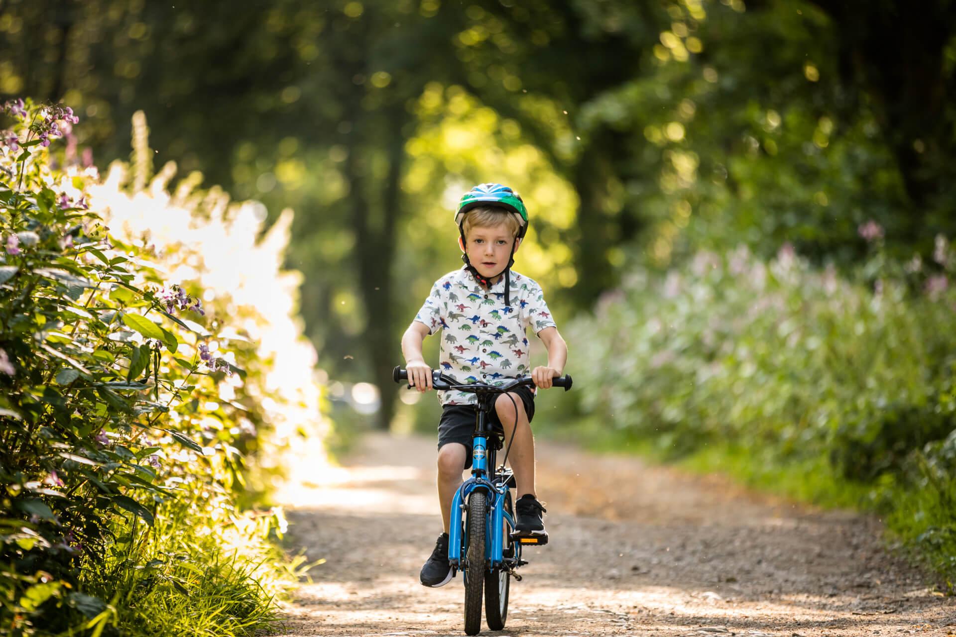 little boy riding his bike in a Leeds park