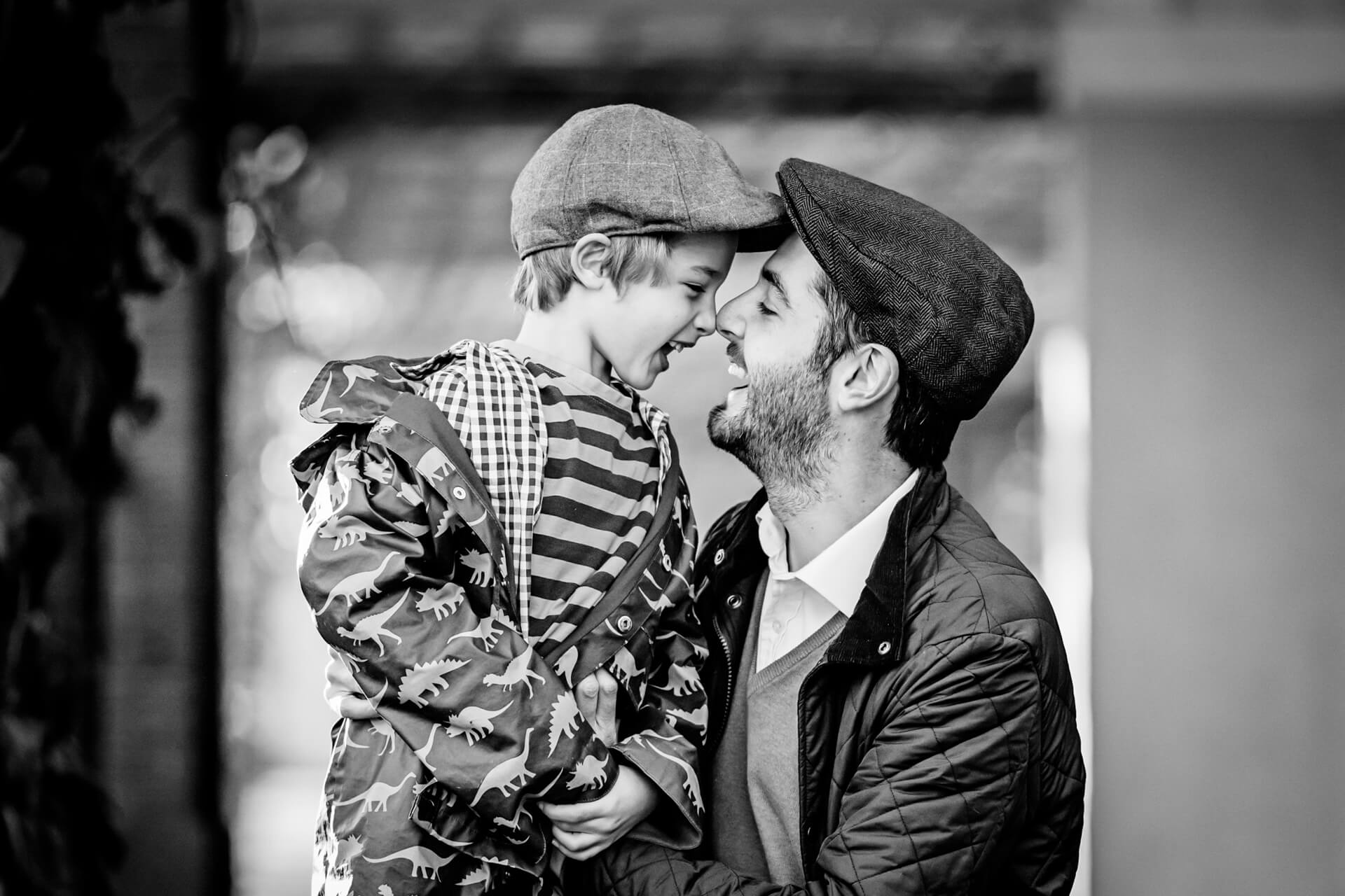 father and his son laughing together